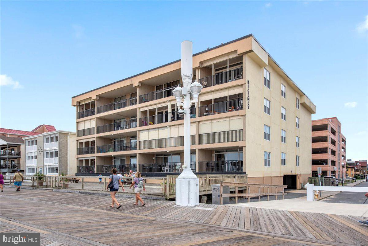 This fantastic end-unit condo is located directly on the North-End of the famous Ocean City Boardwalk with expansive views of the beach and ocean. Step inside to find updated flooring throughout, a spacious living area with added windows and great views of the ocean, a bright eat-in kitchen with coastal white cabinetry, a spacious master suite with en-suite bath, and two roomy guest bedrooms with full bath access. This property is a fantastic rental, bringing in around $40,000 a year in gross rental income. The Regency building offers assigned parking, a storage locker for beach toys, an enormous sun deck with picnic tables,  and a building elevator for easy access. Offered turn-key and fully furnished, this property is ready for you to step into income and enjoy time at the beach.