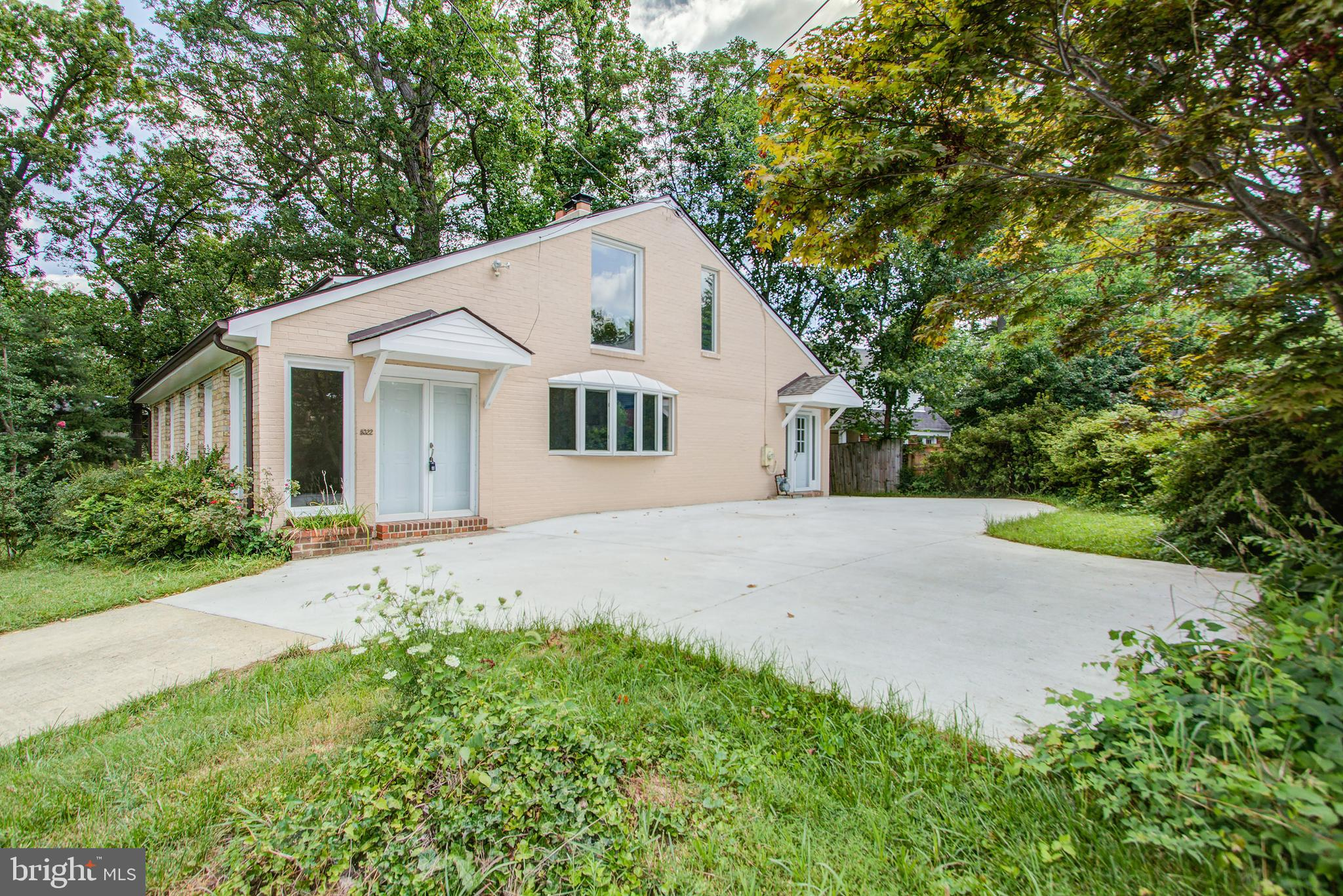 4 BR, 3.5 BA all Brick home with a double master upstairs and lower-level bedroom(s) or office space