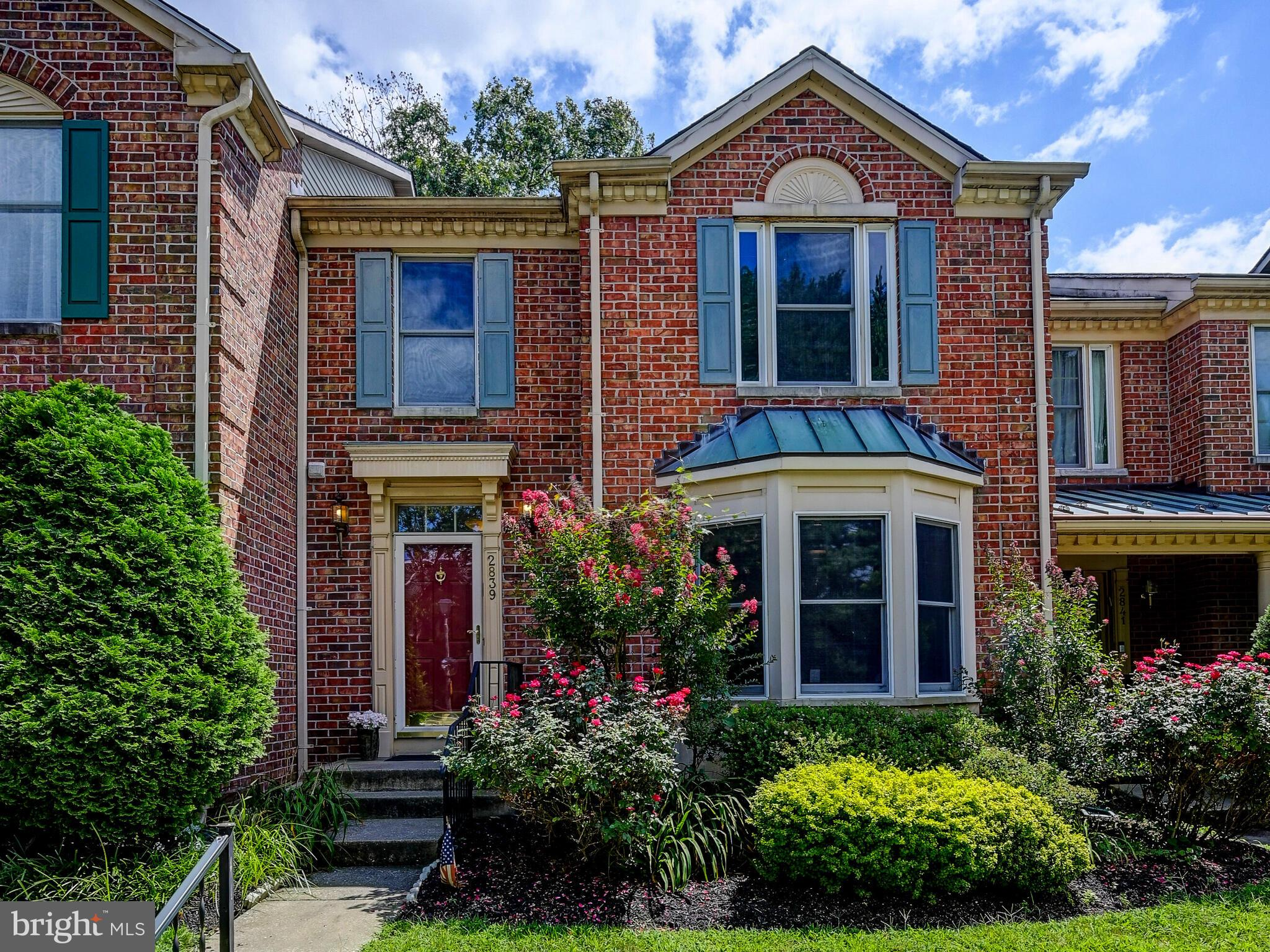 RARELY AVAILABLE! ONE OF THE LARGEST BRICK 3 BEDROOM TOWNHOMES IN GREENSPRING EAST WITH OVER 2,000 S