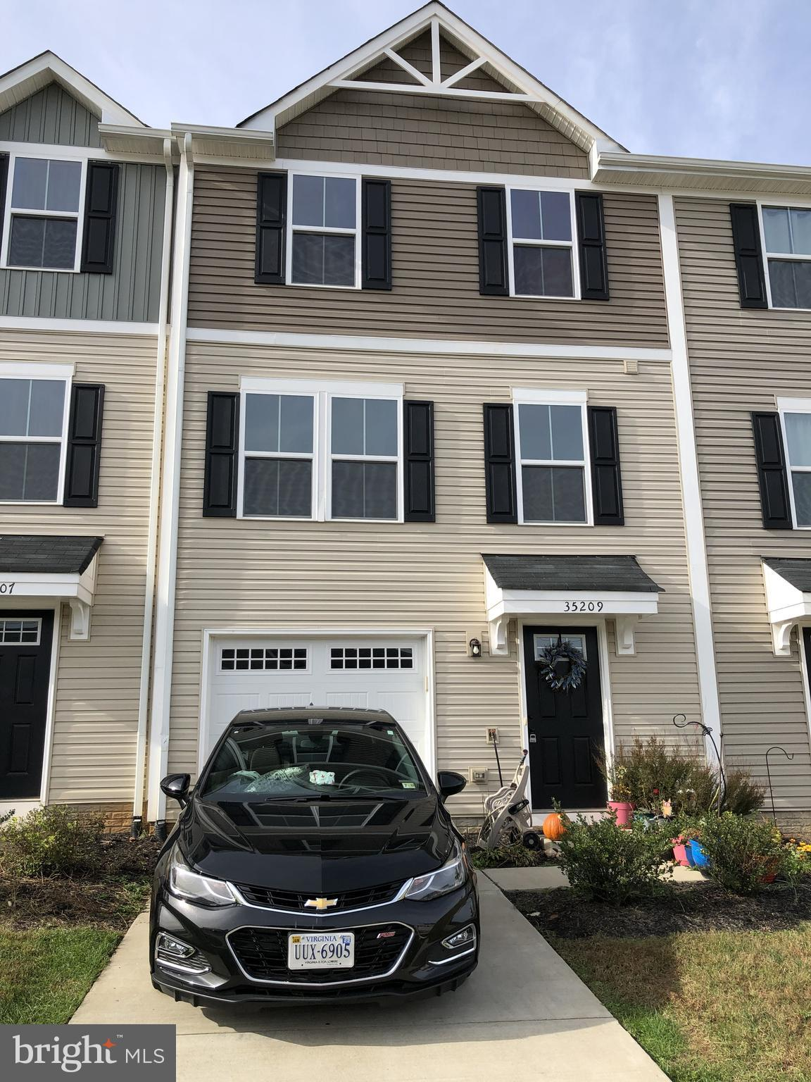 Well-maintained 2 story townhouse with a basement -- fenced backyard & 1 car garage