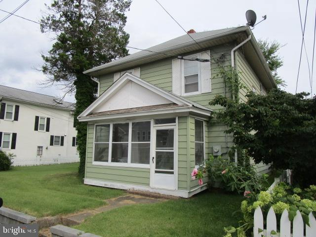 Colonial home with a  nice large double lot could possibly be divided into two!