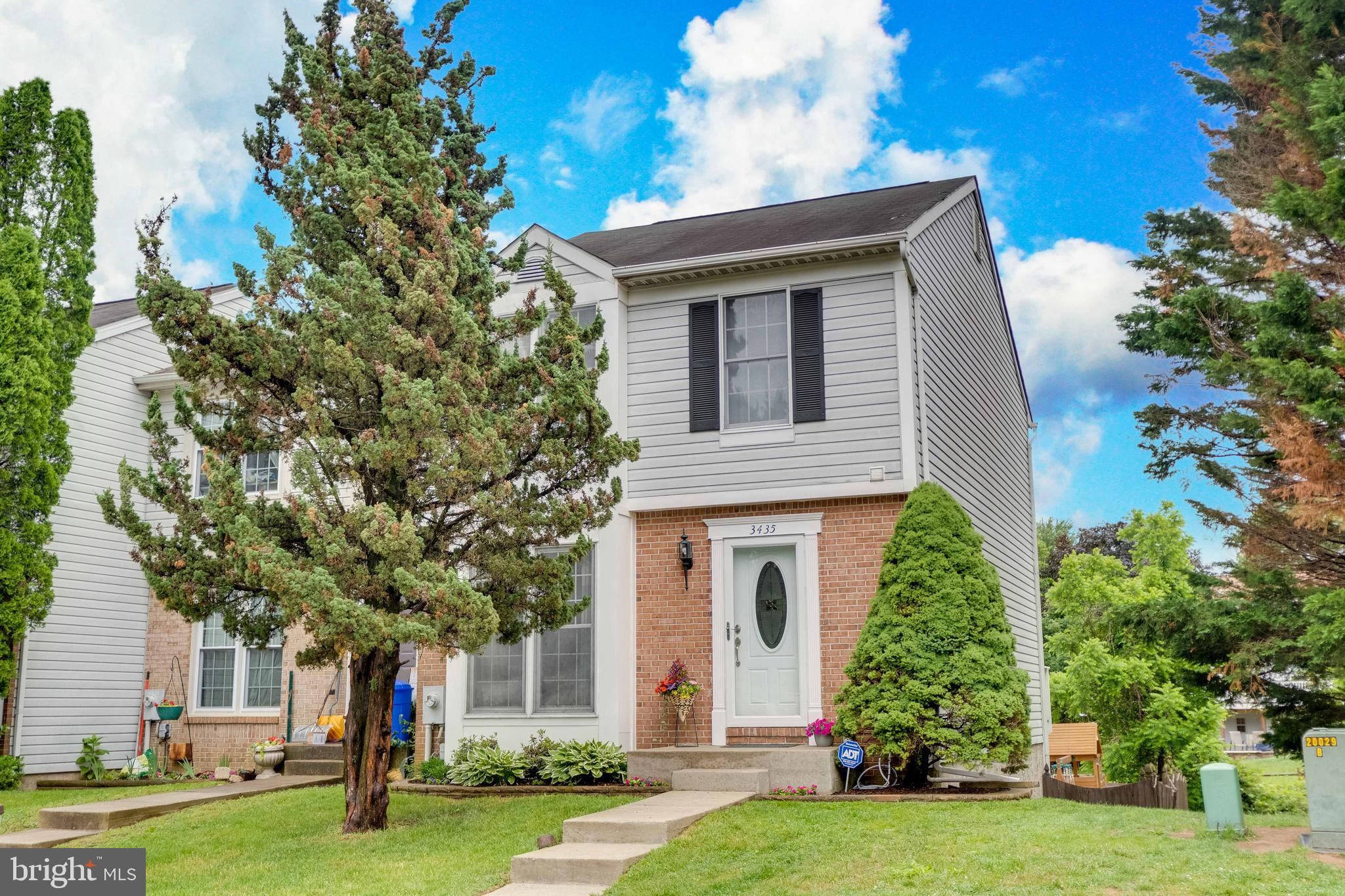 Enticing End-of-Group home with plenty of living on all 3 levels, freshly painted throughout with ma