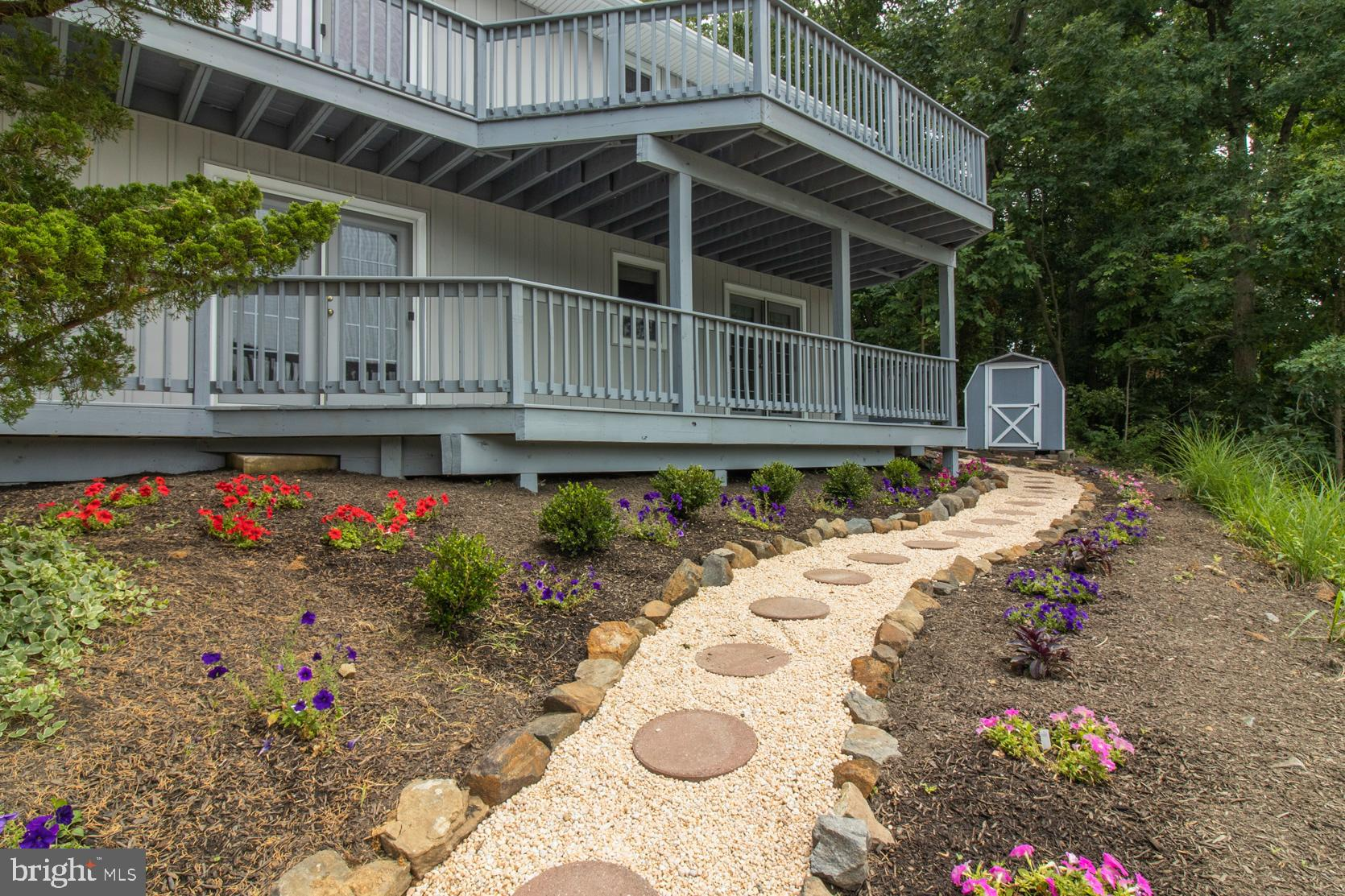 Prepare to be impressed when you enter this superbly maintained hillside home! Both levels are can b
