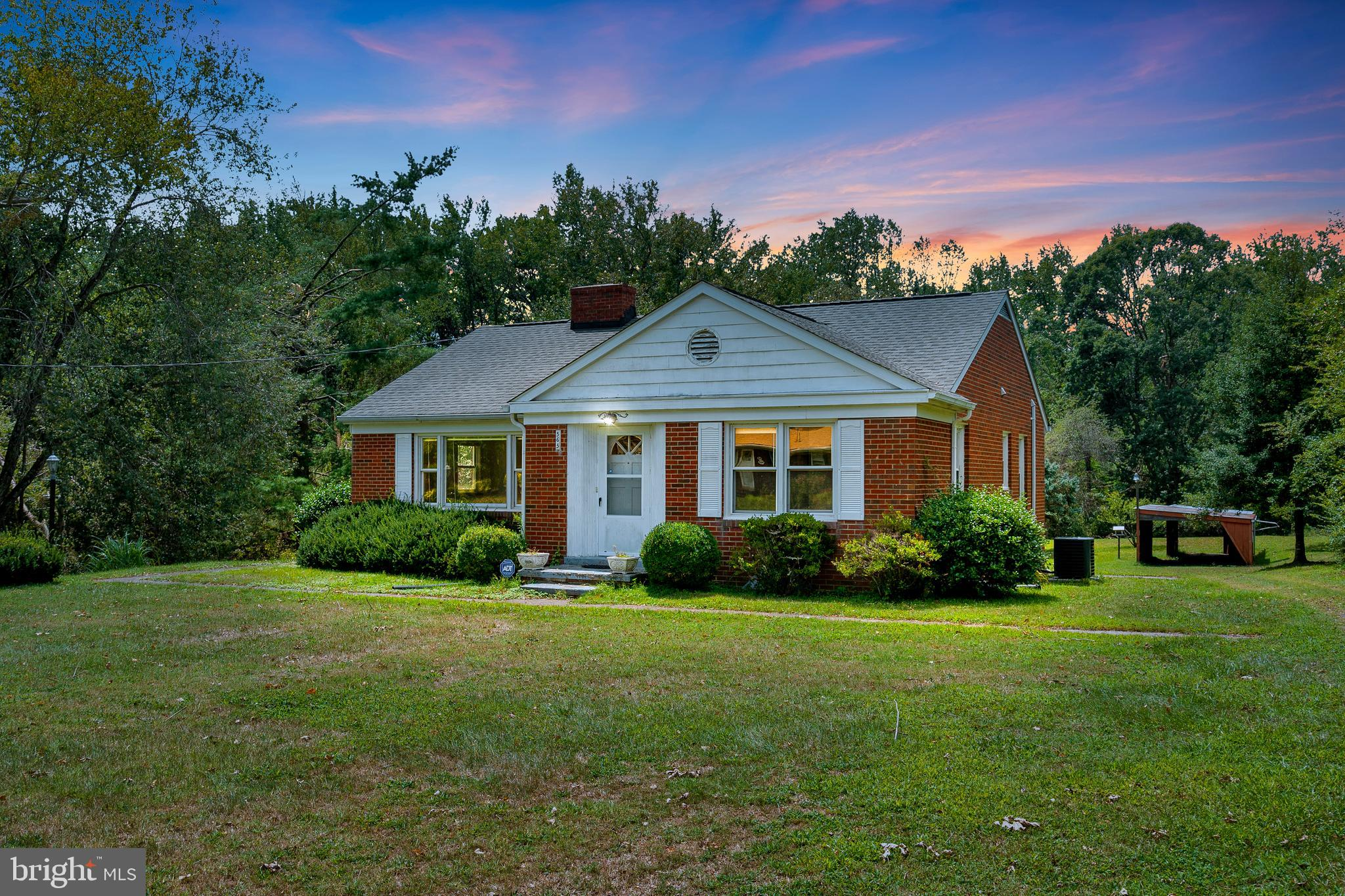 Back on the market! No fault to seller! Hurry to see this charming, all-brick rambler on a large South Stafford lot. Original owner took pride in this lovely home. The living room features a  sunny, picture window and a wood-burning fireplace.  The dining area leads to a three-season room. The three bedrooms feature original hardwood floors. The large, unfinished basement with a second fireplace and outside access to the carport awaits your plans.
