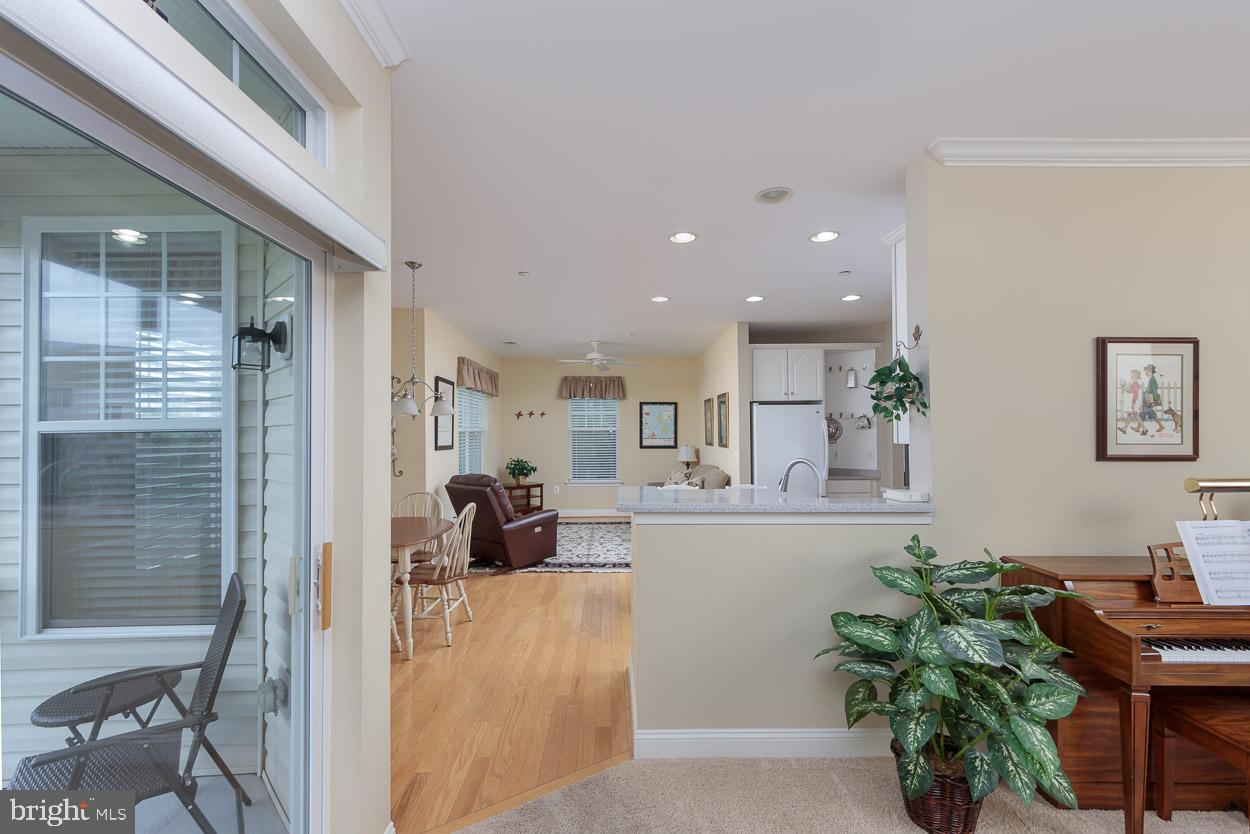 YOU ARE GOING TO 'LOVE' THIS OPEN FLOOR PLAN, 4TH FLOOR UNIT WITH PLENTY OF NATURAL LIGHT AND VIEWS