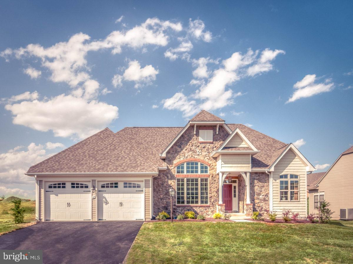 The most sought-after one-level living ranch floor plan! Featuring a luxurious owner's suite, two ad