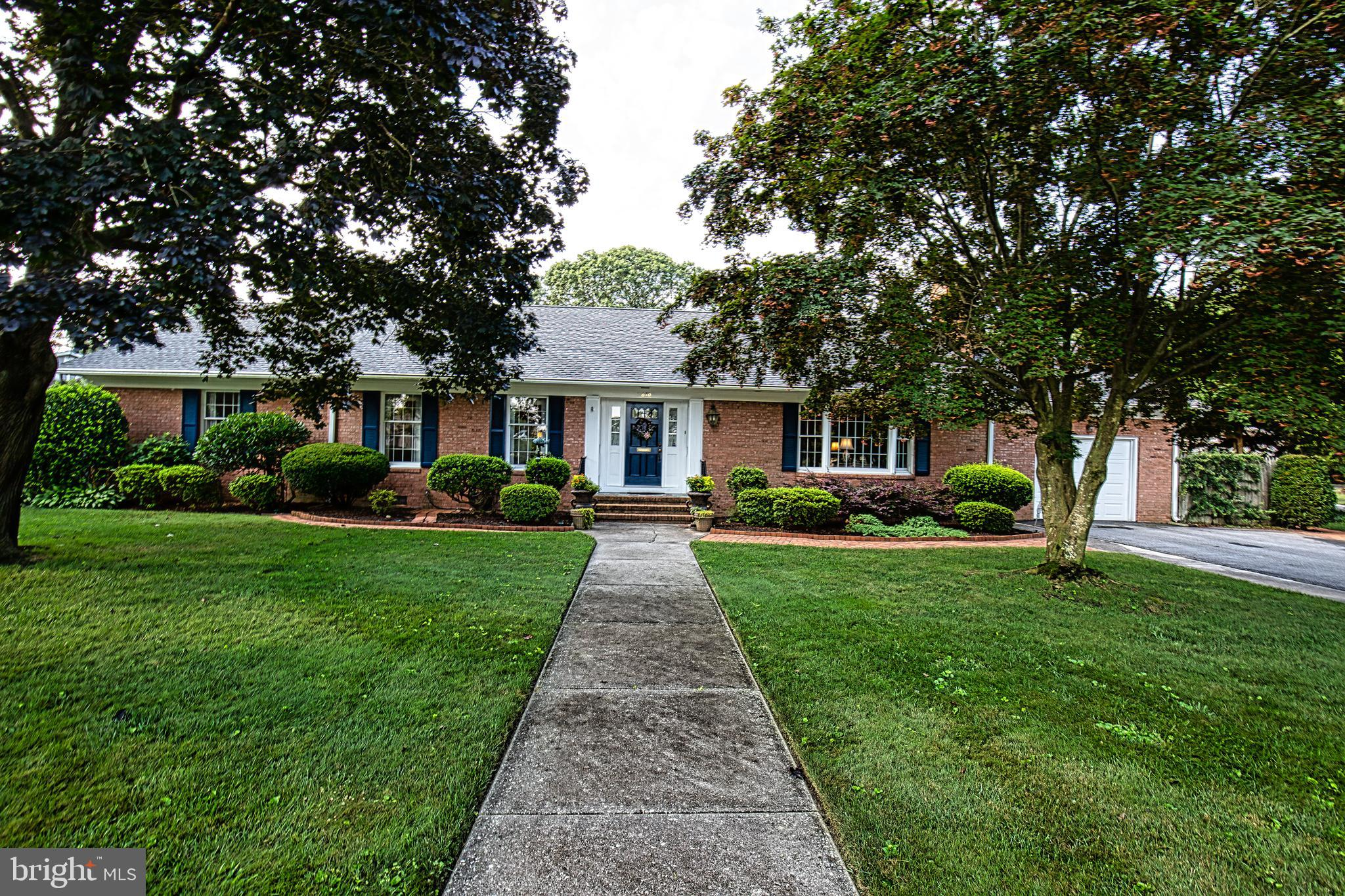 Gracious living best describes this spacious , all brick rancher with attached garage. Generous room