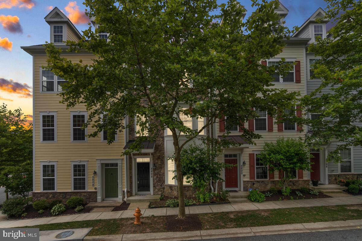 Beautiful three-level stone front garage townhome in Shipley's Grant that's ready for immediate occu