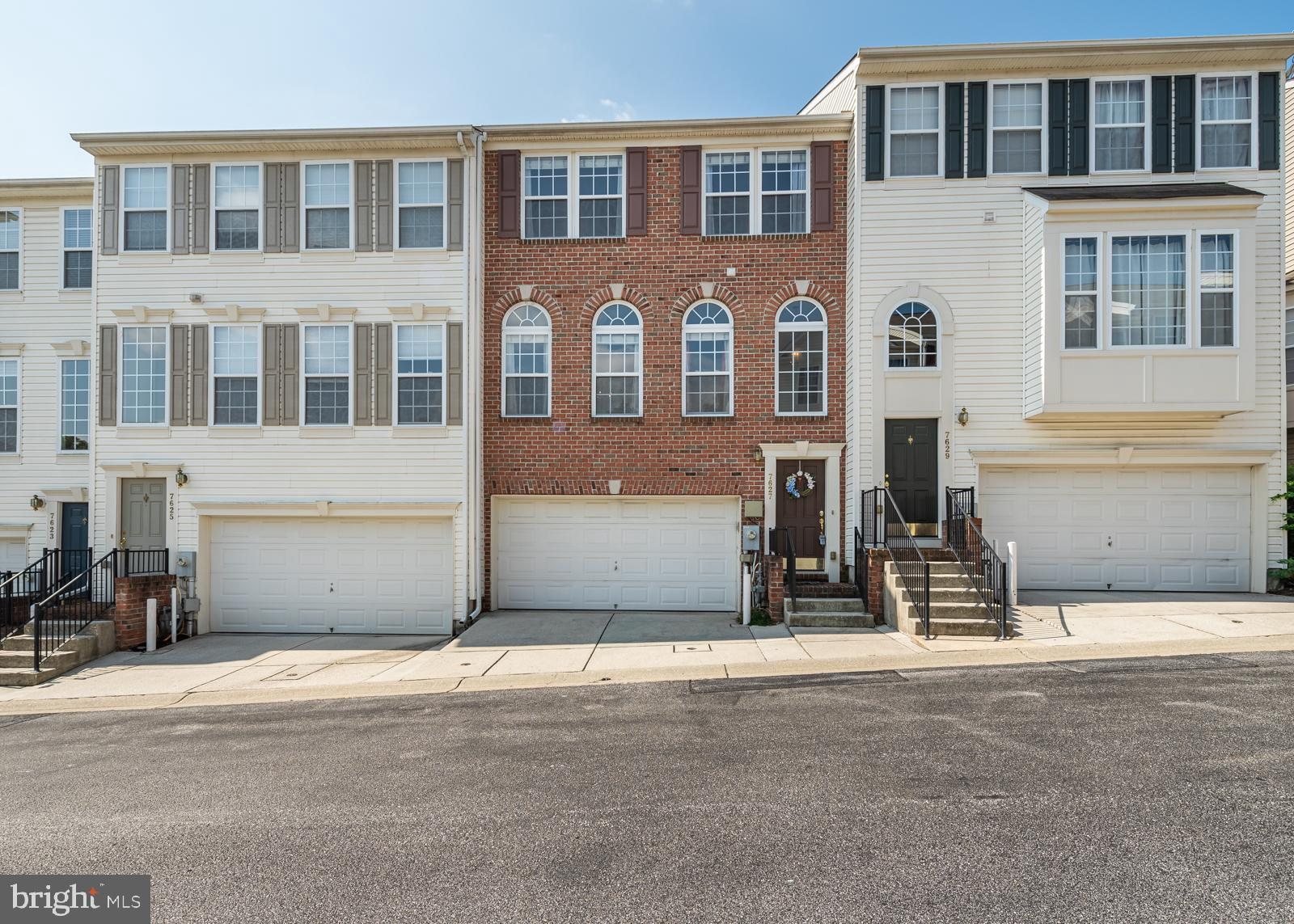 Lovely 3 bedroom, 2.5 bath brick front townhome situated across from neighborhood pool, home feature