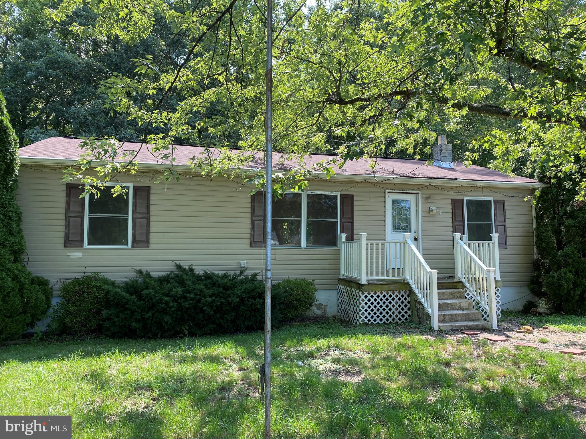 Seller is reviewing any/all fair offers!  This home needs some TLC but has been updated and is move in ready.  Home sold AS IS.   Don't miss the opportunity to own this 1BR/1BA Main Floor and 2 BR/1BA (Bedrooms not to code) in basement. Secluded rural Spotsylvania, so close to Lake Anna.  .91 acres plus an additional 3/4 acre lot goes with it.  Main floor features beautiful hardwood flooring, brand new kitchen cabinets, counter top, sink and ceramic tile!  Main Floor bedroom is huge and has great closet space!  Washer/Dryer convey (as is) and are on the main floor.  Very large, spacious and bright living room area with doors leading out to the brand new deck.  Lower level features 2 more bedrooms with new carpet, family room with wood burning stove, full bath and storage.  Lower level also has a back door leading to the patio under the deck.  There is NO HOA, so make this piece of land work for you!  Build a chicken pen, garden, plant grapes!   Plenty of parking!