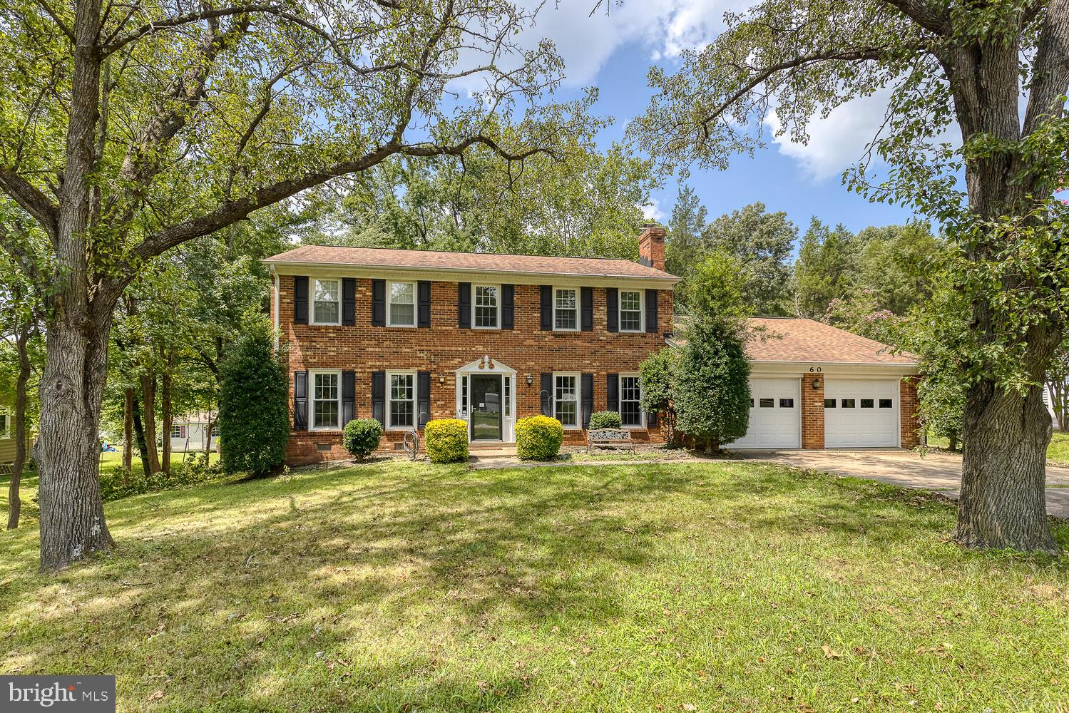 Cozy four bedroom, two and a half bathroom brick Colonial home with large private fenced backyard, f