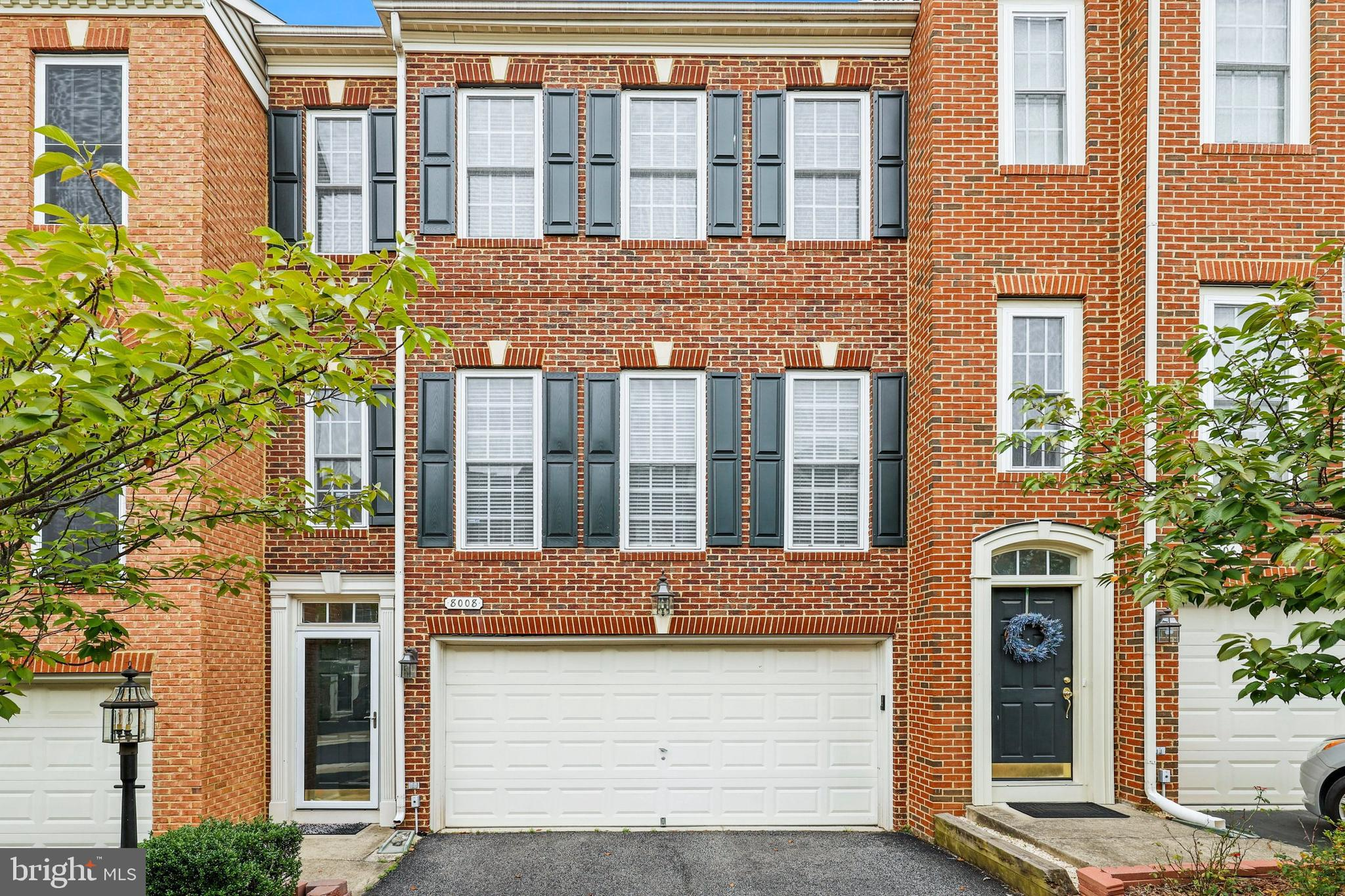 Wonderful brick-front three level townhome in always popular & convenient Lorton Station South is th