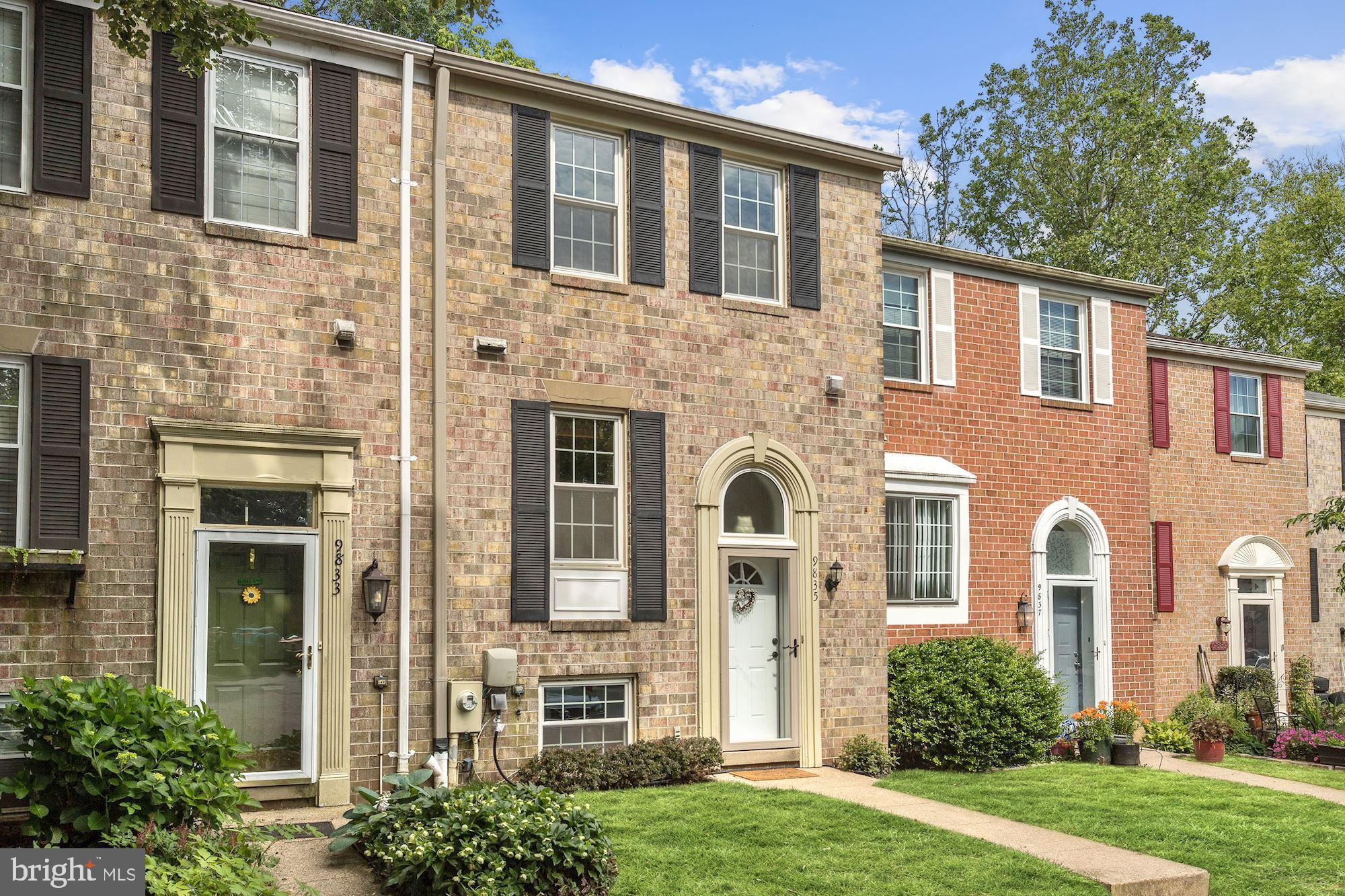 Gorgeous all brick townhome nestled in Kings Contrivance, backs to trees for privacy featuring light