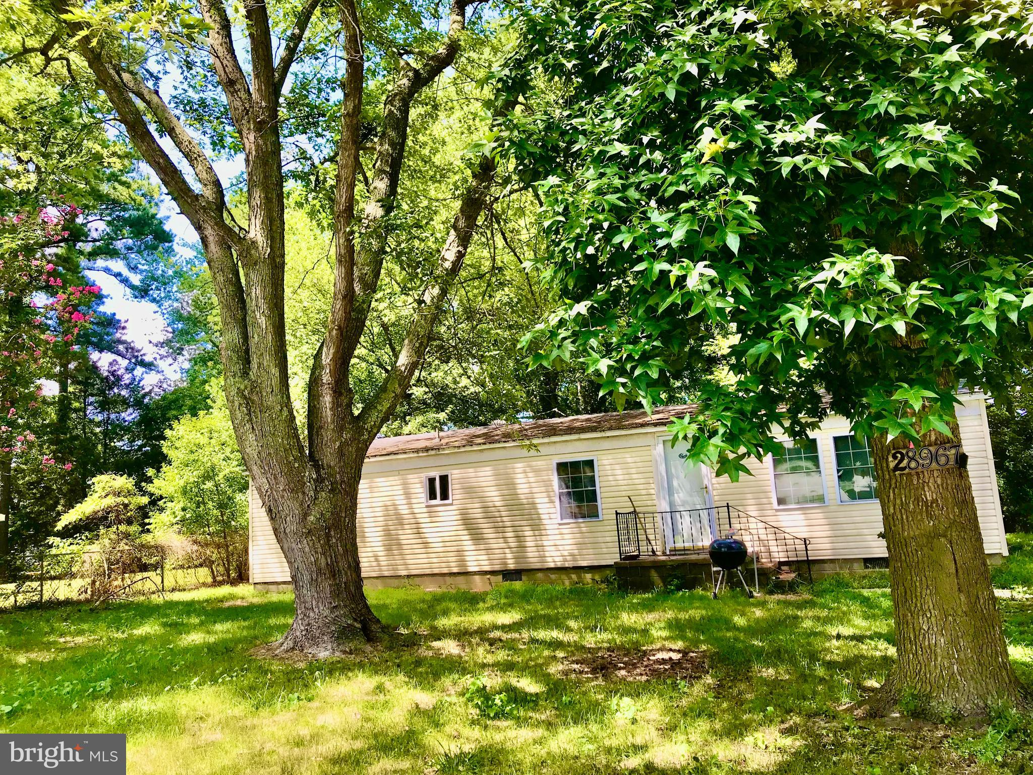 A fixer-upper waiting for your touch!  No HOA! Park your boat or RV here!  Lot is 75x150.  Home has