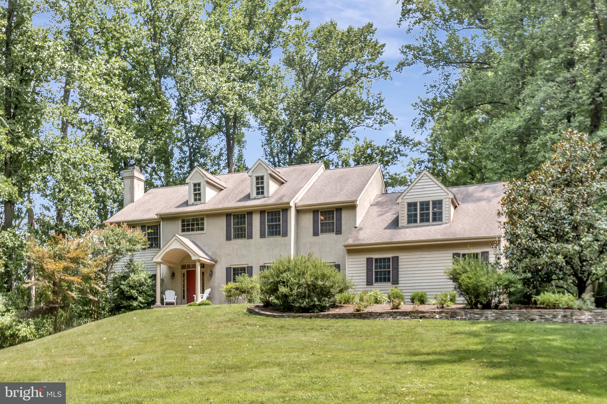Elegant Bancroft-built residence discretely positioned on a private lane off Snuff Mill Road. A grac