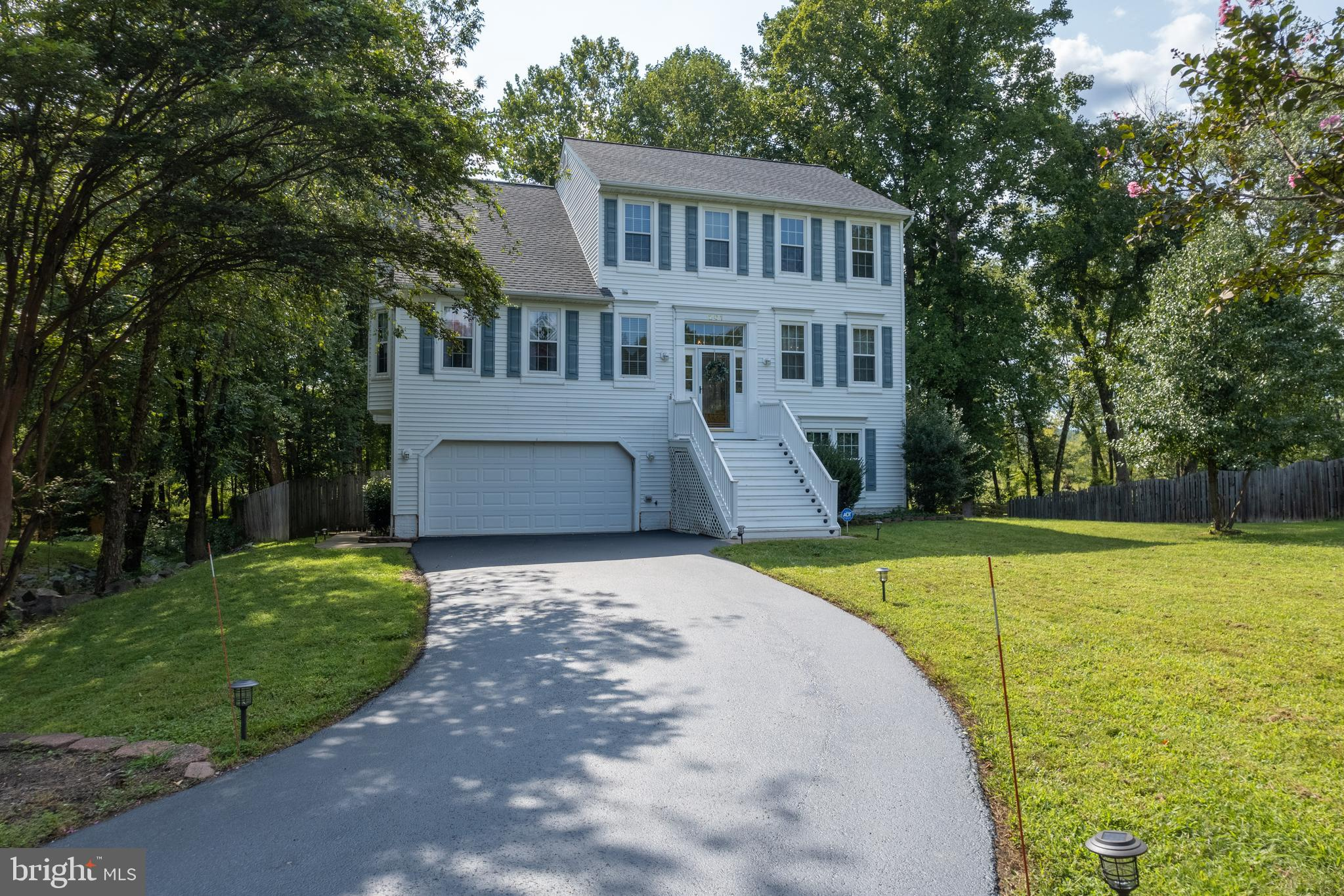 Striking, Thoroughly Updated & Upgraded Three Story,Colonial Home In Aquia Harbor! A large foyer wel