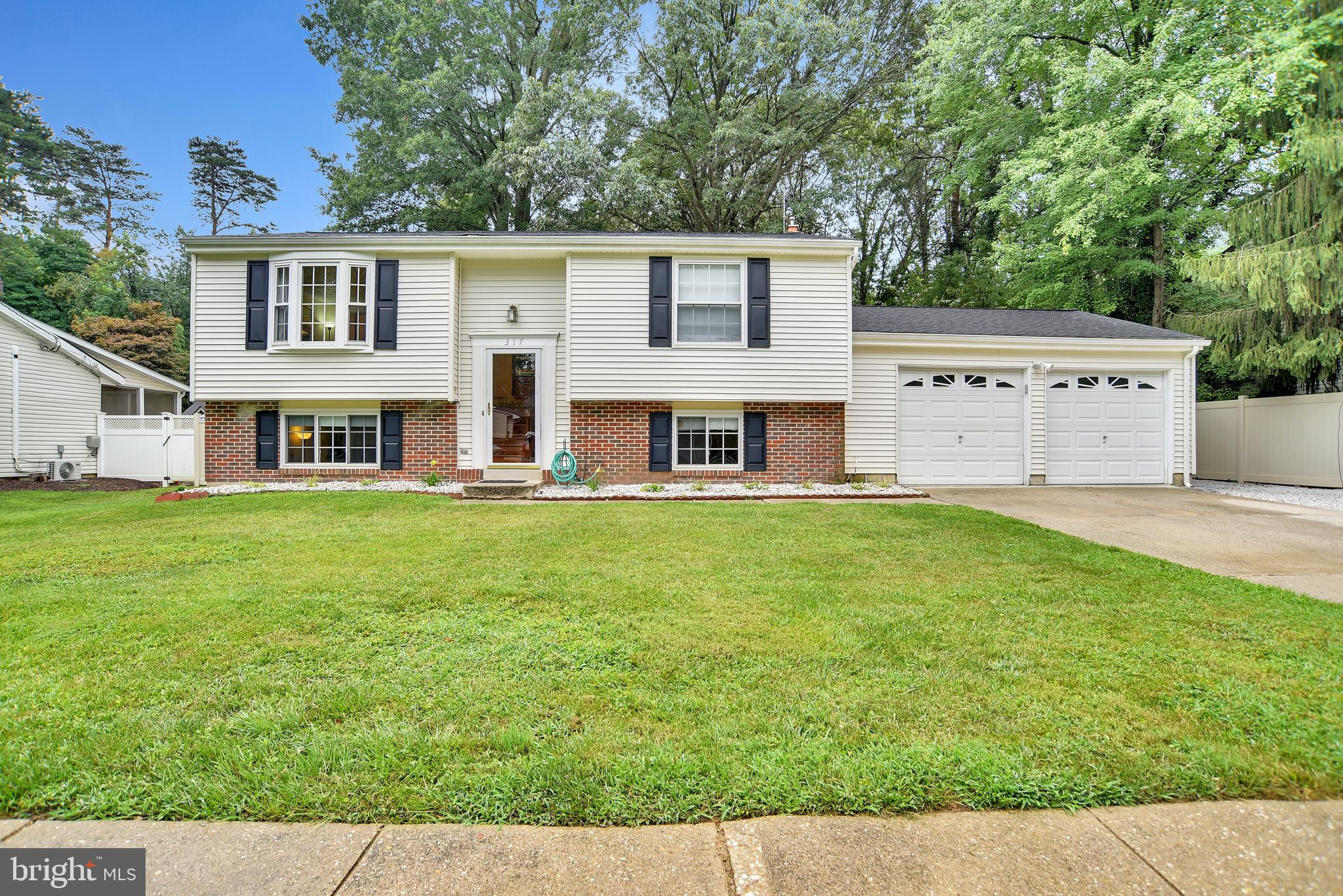 OPEN HOUSE Saturday September 18th 12pm-2pm!!!  Great home in Severna Park with huge 2-car attached garage for less than $500k!!!  Park your boat or RV in your own yard.  Served by the Severna Park school system plus their are loads of awesome recreation, shopping & dining options.  Easily access main routes to the Naval Academy, Ft. Meade, Baltimore, and the District of Columbia .  This Manhattan Beach Split Foyer has more than 1700sf of finished living space and there's plenty of room to grow, too!  The 2-car attached garage is HUGE (more than 500sf), there's a large level rear yard with mature trees and lots of shade, a new (installed late in '19) vinyl privacy fence and much more!  3 bedrooms, 2 full bathrooms plus the 2-car garage and the 3 rear decks including 2 that are covered/roofed decks.  There is a wonderful main floor with a Living Room that basks in natural light, has hardwood flooring and flows into the dining room and kitchen and a sliding glass door that flows onto the main level covered rear deck overlooking your humungous, shaded and fenced level rear yard.   The yard has a double drive-thru gate next to the garage and there is a playhouse/storage shed with electric and it's own porch situated on the rear of the lot.  The lot backs to a community owned Open Space (so no rear neighbor).  The garage has a walkout rear door to a covered deck and that deck connects to an open deck that has stairs to the main level covered deck.   Back inside, the kitchen has updated Stainless Steel appliances, a dual ceramic sink, and a ceramic tile floor.  The Living room and hallway has hardwood flooring and the hall connects to the two upper floor bedrooms which both have laminate wood floors.  There is a beautifully updated full bathroom on the main level, too.  Down the stairs to the lower level we find a large family room with ceramic tile flooring, loads of natural lighting and a corner pellet stove to take the chill off on a cool autumn or winter night.  The o