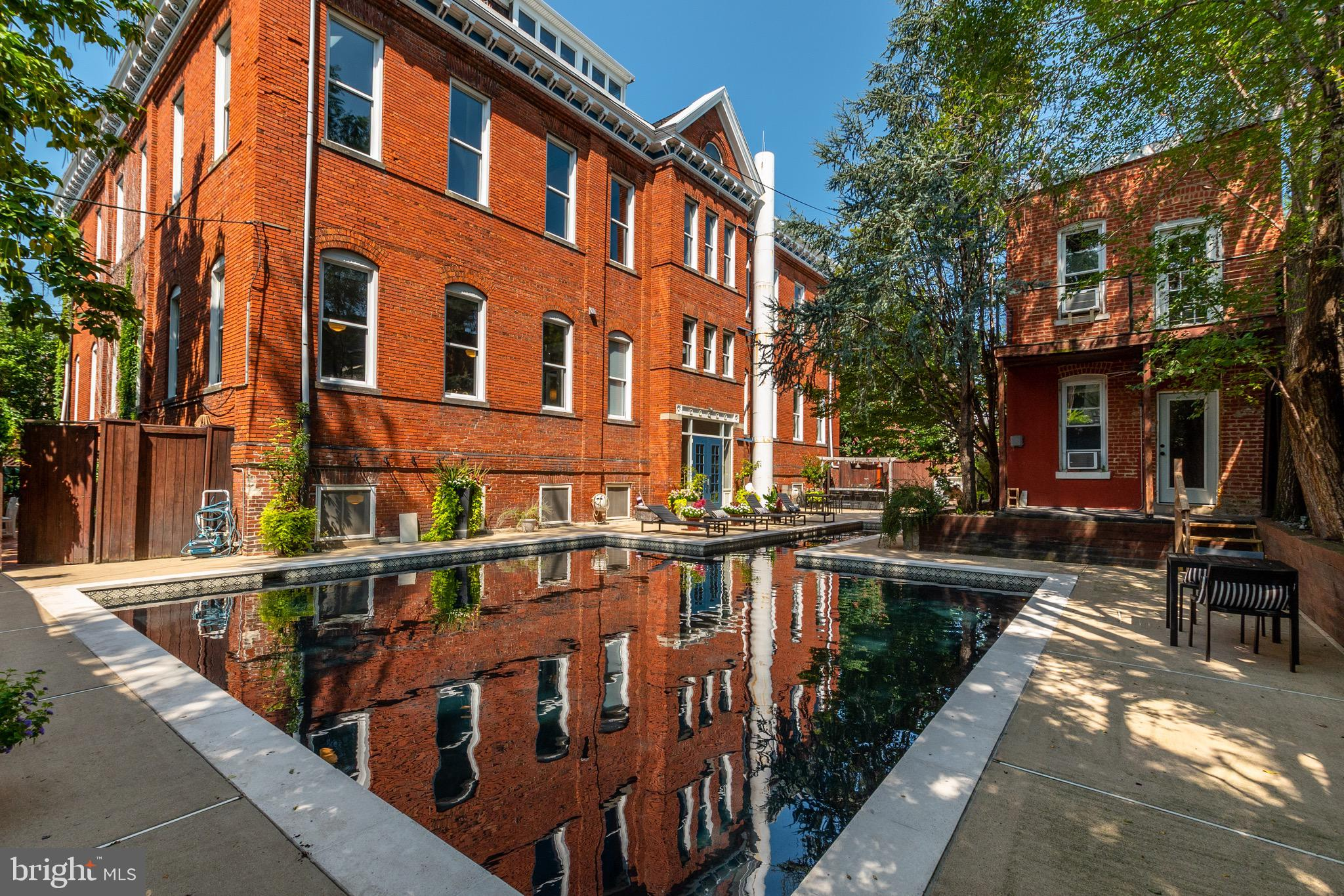 Light and airy 1 bed / 1 bath condo with massive private patio & black bottom pool! With over 1300 s