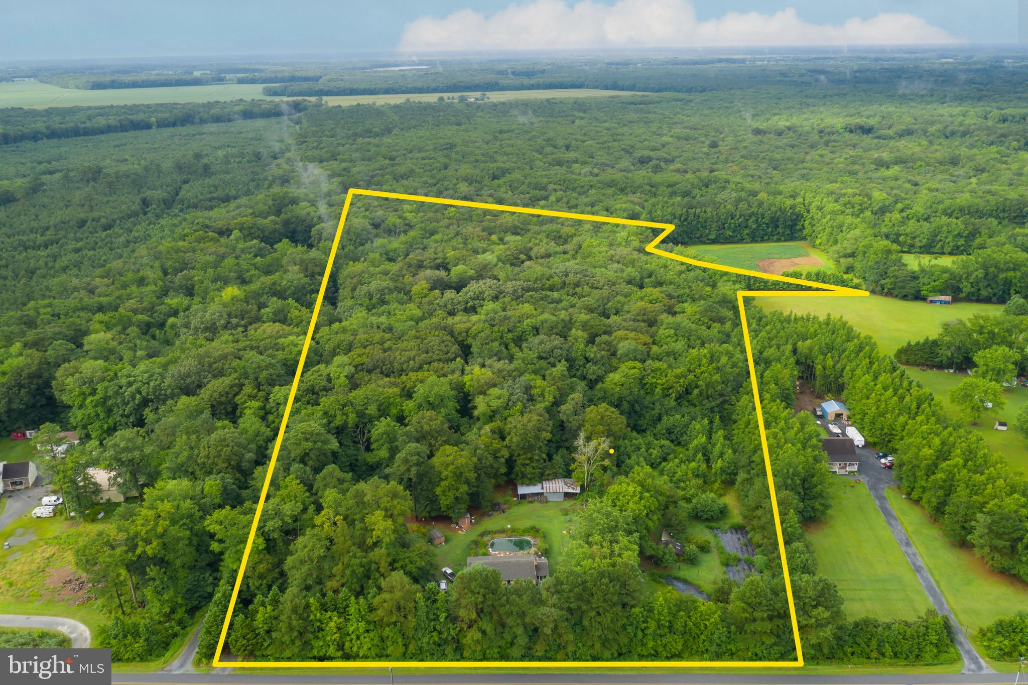 Opportunity abounds on 17.48 acres at 9036 Peerless Rd Whaleyville, MD. This property offers seclusi