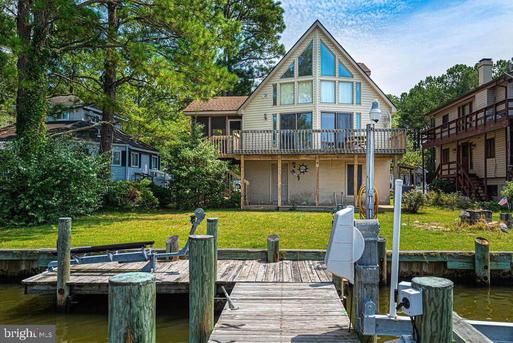 WOW!    Exceptionally well maintained by original owner, 3 BR / 2 BA estate sale home on a wide canal in Ocean Pines.   Very few homes have this type of waterview.    Garage is way oversized, you might actually fit 4 cars!   The beautiful screened in porch has fantastic bay views as well great wide canal views.   Perpendicular pier has a motorized boat lift.    The water views from the Great room or the adjoining deck  are unbelievable!   Professional photos coming soon.   You Need to See this One before it is SOLD!