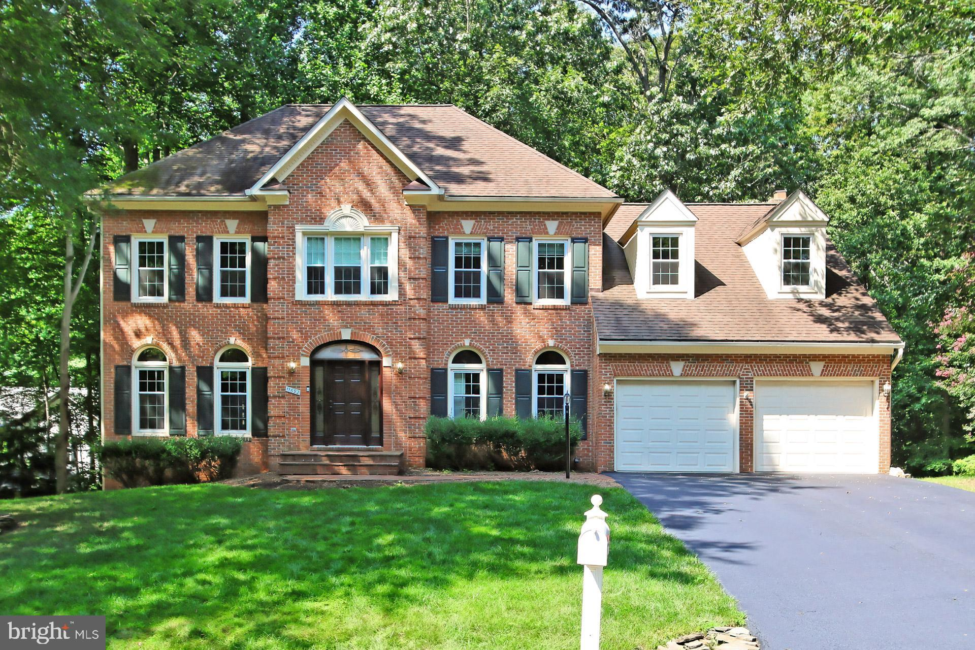 Welcome to 11692 Sandal Wood Lane in Manassas, Virginia!Lovingly nestled amongst the trees on a serene 2.19 acre lot in the Riverview Estates neighborhood, this 5 bedroom, 4.5 bath Colonial home features a stately brick façade, 2-car garage, 2-level deck, paver patio, and an abundance of windows uniting indoor and outdoor living. On trend neutral paint, hardwood floors, large room sizes, decorative moldings, fireplace, and an updated kitchen are only some of the fine details that make this home so appealing. This secluded retreat makes you feel many miles away from the hustle and bustle of Northern Virginia yet is centrally located to Route 234, the Prince William Parkway, VRE, and diverse shopping, dining, and entertainment choices in every direction. Everyone will enjoy the nature trails, serene tranquility, and planned neighborhood activities or take a short drive and visit Northern Virginia's best kept secret—Prince William Forest Park offering 15,000 acres of woods, streams, fragile ecosystems, and endless activities for nature lovers. For a home that offers a convenience in commute and, at the end of the day, a serene place to come home to and enjoy, you've found it. Welcome home!