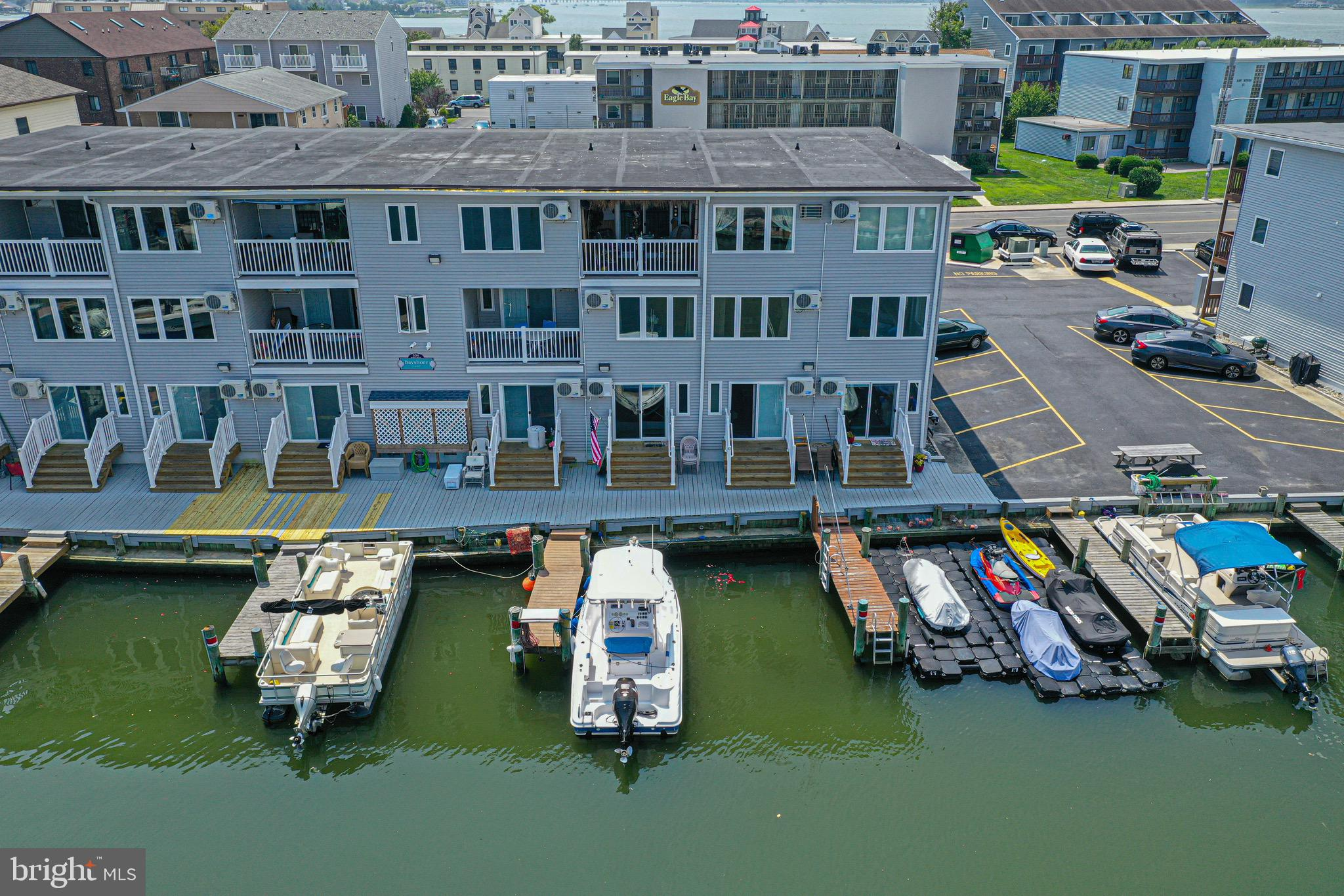 Rare find! Prime location in Ocean City, Maryland! Enjoy the best of both worlds! Convenient first floor condo with direct walk-out access to a deeded boat slip (#32), and perfect central location offers a short walk or bike ride to the beach, boardwalk, restaurants, bars, and entertainment such as Jolly Rogers Amusement & Water Park. Enjoy the beautiful views of the water and sunsets! There is also a private boat ramp for Bayshore owners and renters to use that makes dropping your boat or jet skis into the water a breeze. Condo boasts new ductless heating & cooling mini-slit, new vinyl plank flooring, new sliding glass doors with internal mini-blinds, new refrigerator, fully furnished, & plenty of natural light. Recent building renovations include new siding, soffit, gutters, windows, LED lighting, vinyl railings, landscaping, and building security cameras & system. It would make an excellent home for a family, second home getaway at the beach, or could be a great rental property!  There is an assigned storage closet for your beach & boating gear and storage needs within the building. Quarterly condo fees include cable, water, common area maintenance, building flood/wind/hazard insurance, and city water & trash fees.  Seller will pay remaining balance of special assessment  with an acceptable offer.