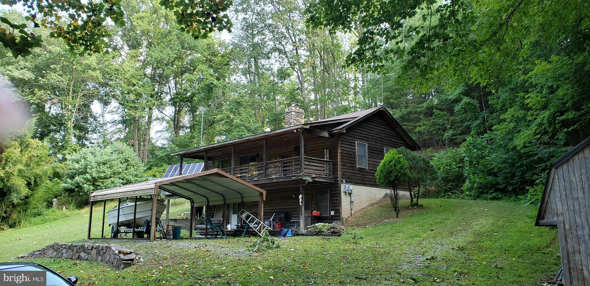 Wonderful energy efficient home with complete solar system that you can choose to live off the grid