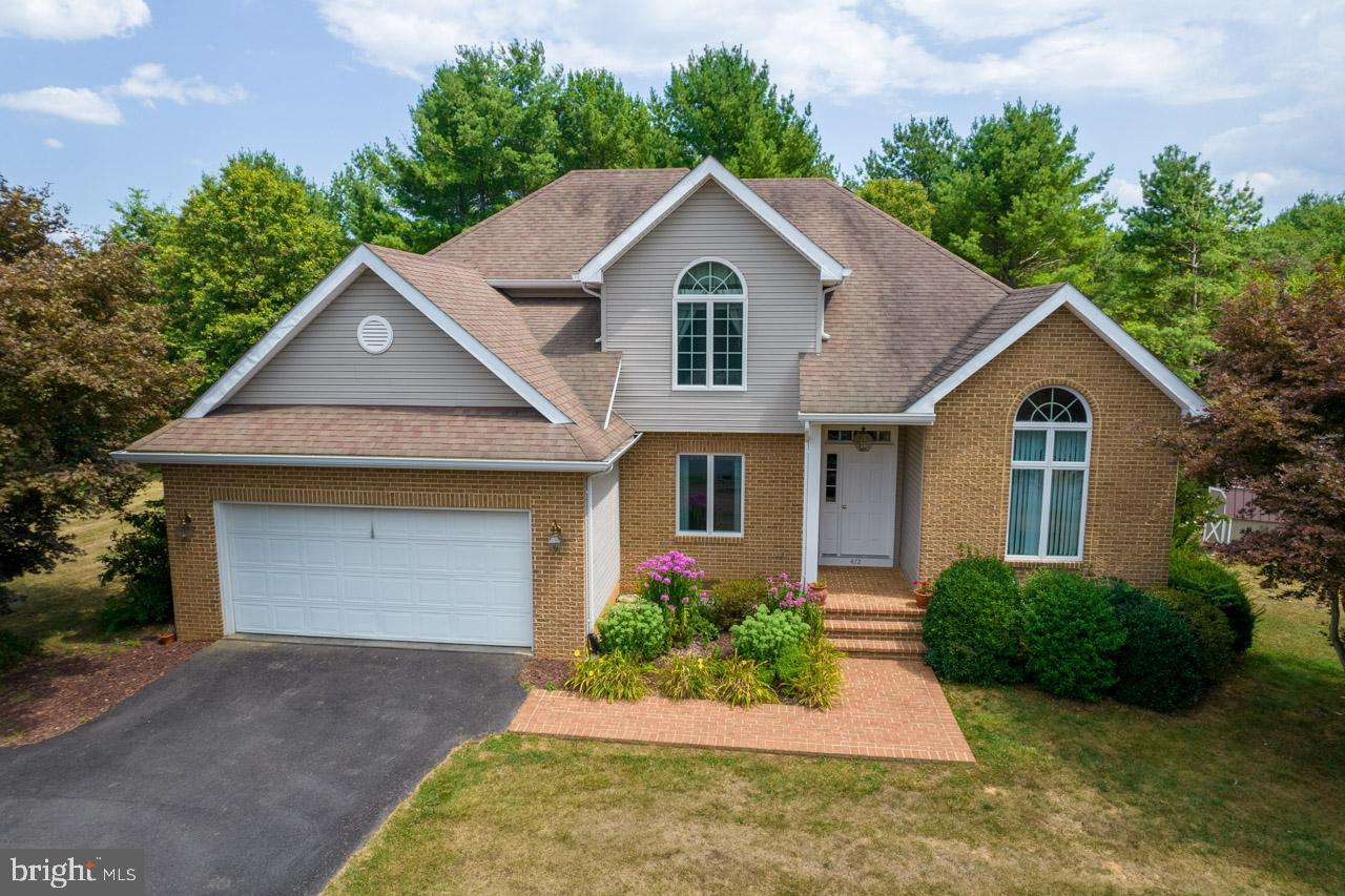 Well maintained 4 bedrooms, 2 full baths, one half bath Colonial on  1.6 acre lot  backing up to the Bowling Green Golf Course.  Walk into the foyer with beautiful hardwood floors with vaulted ceiling. Formal dining area overlooks the beautiful front yard. Country kitchen with a nook for easy dining. Living area with a view into the back yard and the golf course. Front office space on the main level.  Primary bedroom with large primary full bath. Second floor consists of 3 bedrooms, one full bath and a large walk in attic, great for storage. Large partially finished basement with utility/wood working area. Great for storage or extra space.   Back deck over looking the golf course makes for great entertaining.  Come take a look today! MOTIVATED SELLERS!   BRING OFFERS!   PRICE REDUCED