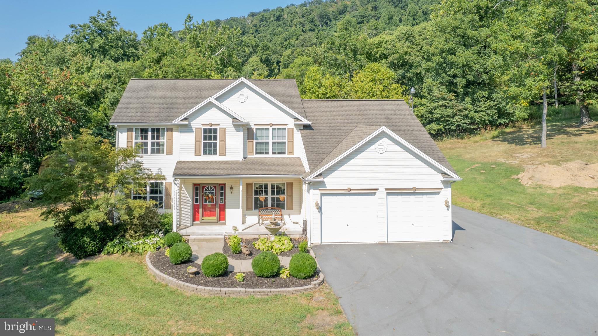 Every detail accounted for in this gorgeous 4BR/ 3A, over 3,500 SF home situated on 1.82 unrestricted acres. Fall in love with the quiet, country setting only a few miles from local hospital and amenities.  The layout and size create endless possibilities for raising a family, entertaining guests or retiring in luxury.   Open the front door to a grand two story entranceway with custom hardwood floors and stairwell.  To your  right, retreat to your own home office or library complete with French doors making it an opportunity for a main floor bedroom if needed.  To your left, the stunning formal living room is full of natural light and space to create family memories.  Straight ahead you will find an amazing open floor plan perfect for Sunday games--The artisan kitchen with granite counters and bar open to an eat-in sunroom area and the family room.   The charm of the family room starts with the custom inlays on the hardwood floors and is punctuated by the mantled gas fireplace. You will love the energy efficient appliances, HVAC system, windows, and insulation making this home as cozy as it is cost-effective.  Custom lighting and speakers are just a few of the details not to miss on the main floor.   Enjoy a  well finished two car garage, laundry room, pantry , guest bathroom and many closets on this level as well.  Upstairs boasts the bedrooms of which each have large closets and a spacious floor plan.   The owner's suite shows off with oversized walk in closet and luxury spa bathroom complete with soaking tub and stand up shower.   Gorgeous custom window treatments throughout the home convey.   The fully finished basement has numerous coves for storage as well as a huge unfinished space with ample room for a workshop or storage.   The finished rooms will be the hang out spot for movies, art projects, fitness and so much more.  Once outside you can bird watch, sip coffee and enjoy peace on the custom patio.   Beautifully manicured, the yard is a treasure trove of o