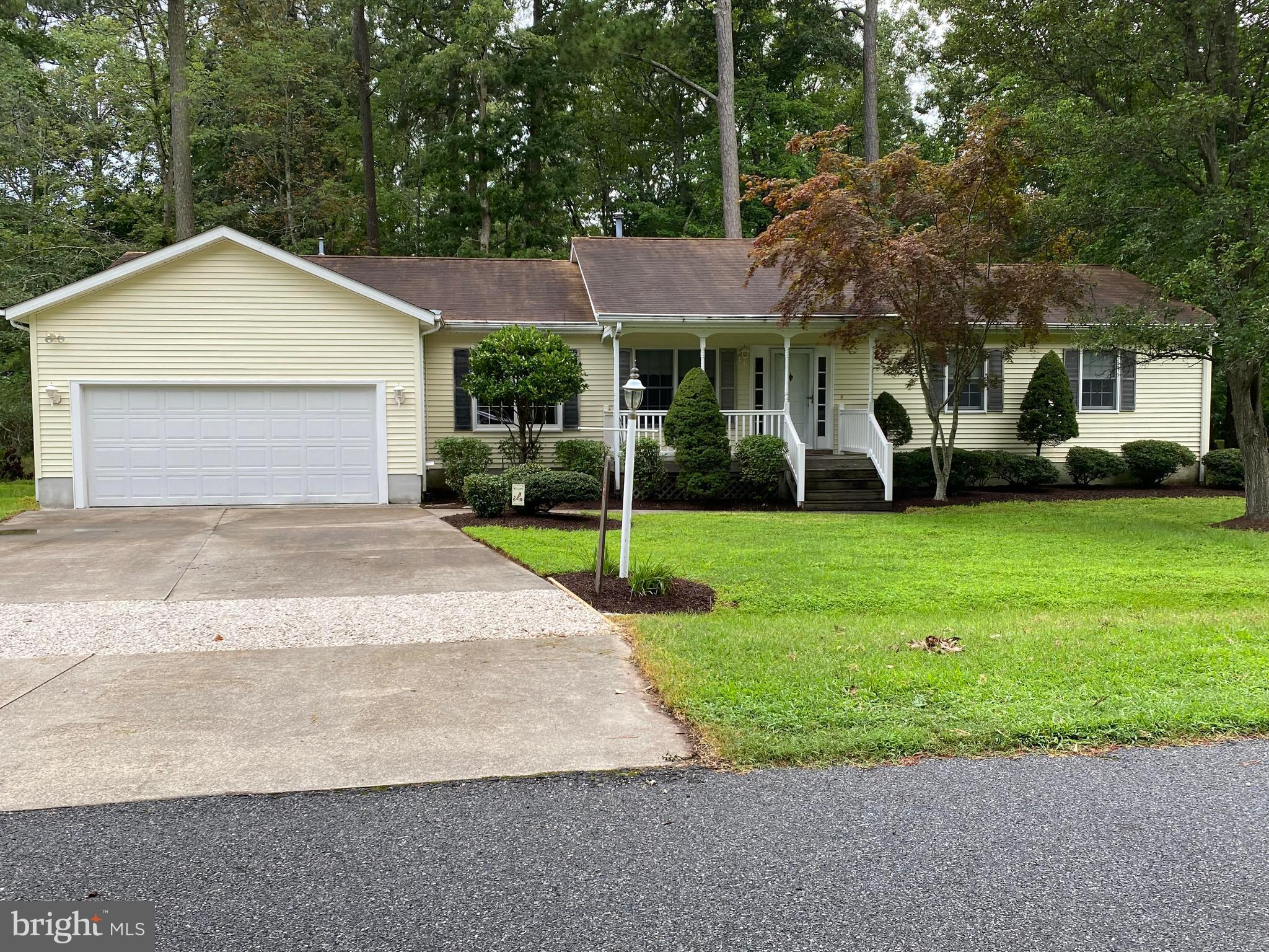 Well maintained single family home with screened porch on rear with partially fenced rear yard and a