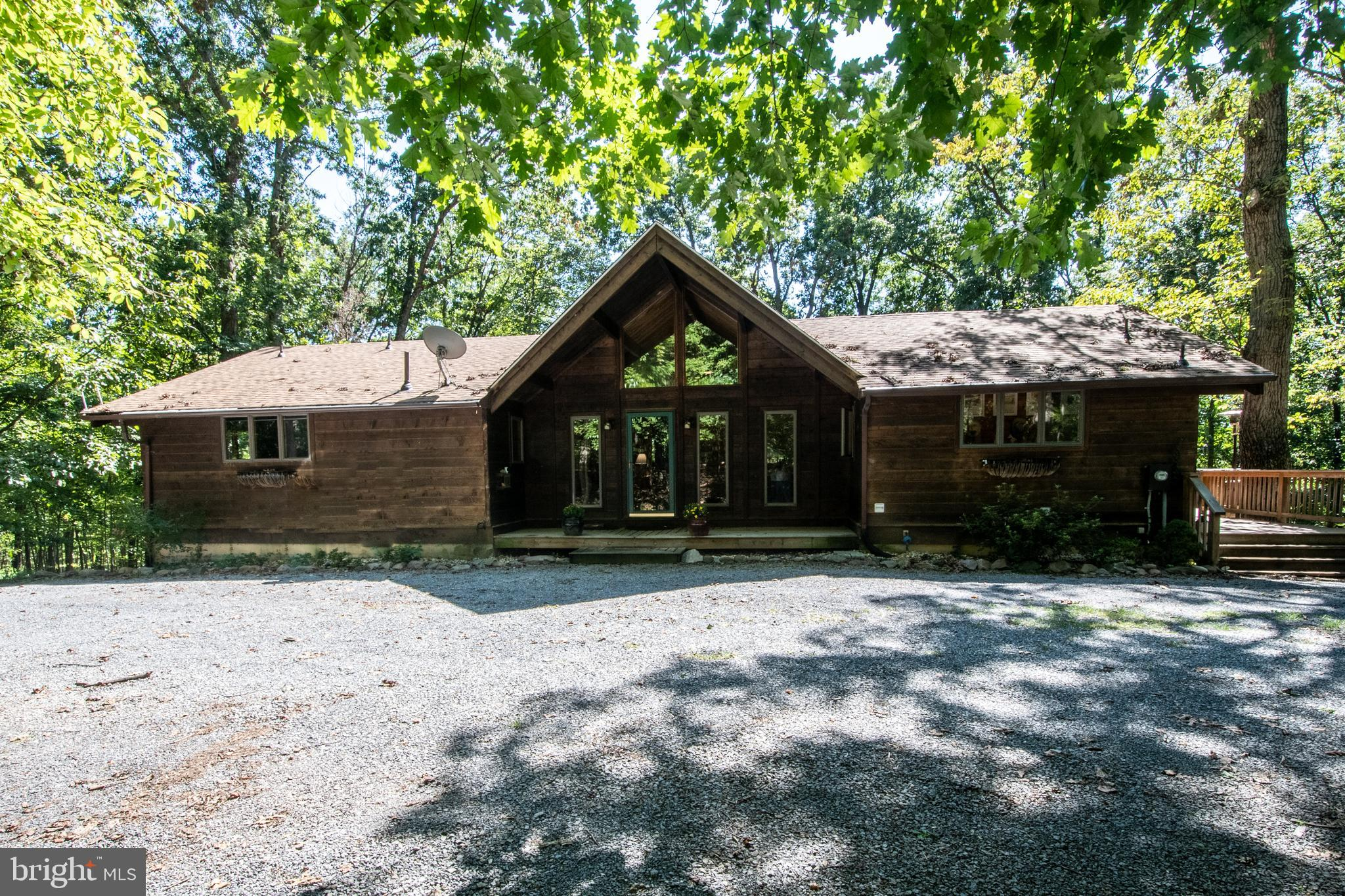 Awesome Cedar/Log style home on your private 5.07 acres is nestled in the woods, amidst the forest c