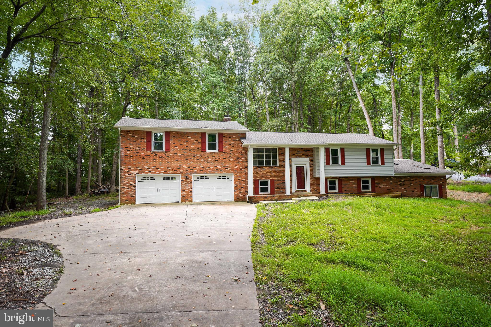 TRI-LEVEL WITH ACREAGE AND NO HOA***HOT TUB, BAR, SEPARATE APARTMENT WITH KITCHENETTE, TWO DECKS, 2 CAR GARAGE, UPDATED APPLIANCES -LOTS OF POTENTIAL HERE***VACANT AND READY FOR QUICK SETTLEMENT.