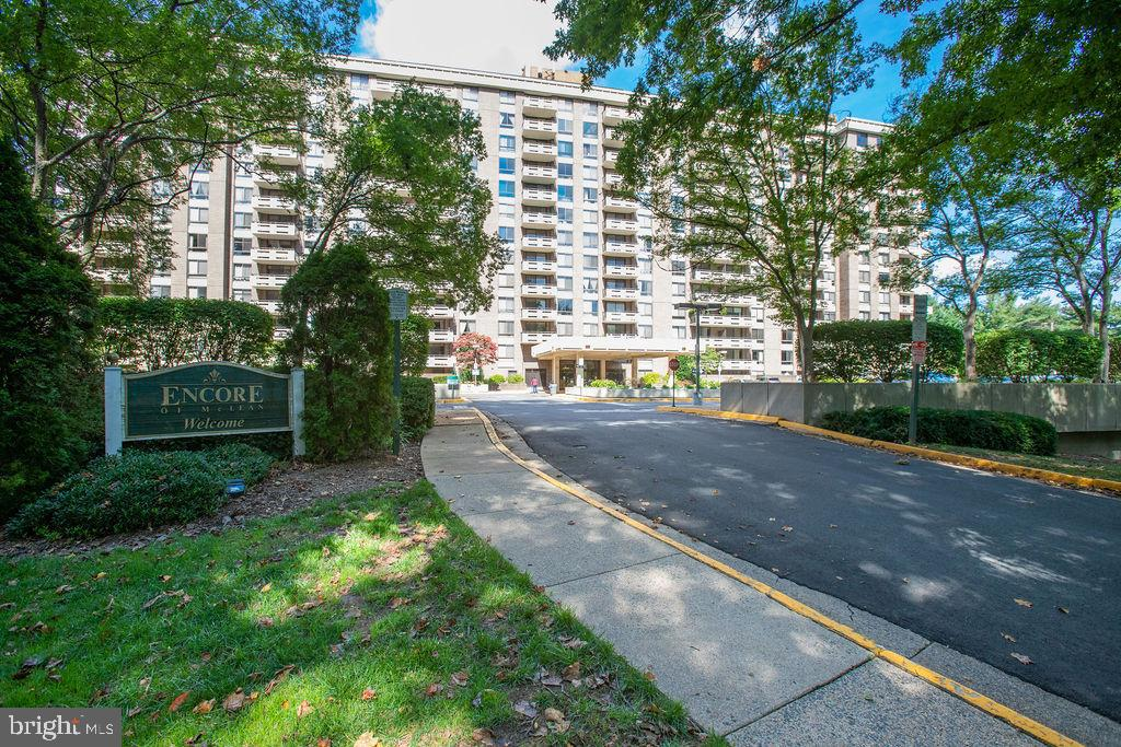 OPEN HOUSE Sunday OCT 17th 2-4 pm...HUGE $28,000 Price Reduction!!...ENTERTAINERS DELIGHT in Capitol One-Tysons Corner McLean METRO Station area! PRIVATE and LARGE 1305 sq ft 2 BR 2BA END main floor unit. Features an oversized 8 foot brick wall Georgetown 350 square foot PATIO accessed by two sliding glass doors. Only 2 other units on this floor's main entrance hallway makes it quiet compared to almost any other building layout since there isn't a neighbor across the hall -- very unique!  Thick CONCRETE CONSTRUCTION makes Encore living much quieter than most thin-walled construction done today. Unit 106 is also on the quiet (non-Beltway) East side of the building. -- Did I say PRIVATE and QUIET?....The workout room down the hall boasts quality EXERCISE EQUIPMENT. Both male & female changing rooms include a hot SAUNA room & showers. Relax with your favorite book in the LIBRARY and meet neighbors in the community SOCIAL ROOM opposite the welcoming lobby..... Convenient access just across hall to common area which connects to PET AREA and WOODED GROUNDS. Secure BICYCLE STORAGE room just one floor below on same end of hallway.  One assigned deeded indoor GARAGE PARKING spot #202 located next to a column (so you don't have cars on both sides). Secure STORAGE UNIT #18 bigger than smaller cages offered in most buildings today. Only one floor stairwell access to underground garage. Additional outdoor parking space for rent $40 per month. No need to use the elevators. Just pop down the stairwell one floor to your car in the garage or your storage unit..... KITCHEN COOKS will appreciate the stainless CONVECTION MIROWAVE oven and NEW STAINLESS DOUBLE DOOR RANGE cooking two different dishes at the same time. The new range has the fastest boiling cooktop elements available and the largest oven capacity (7.3 cubic feet)in its class. The bottom oven is also a convection oven!  There is plenty of food prep area with two long GRANITE COUNTERS. Have lots of favorite foods and kitchen