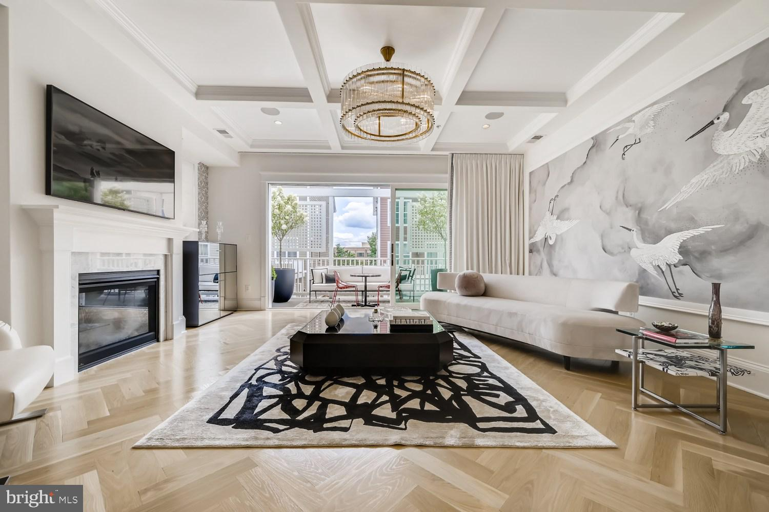 This architecturally stunning and newly built four-level contemporary end-of-group townhouse boasts over 2,800 square feet of elevated living featuring three bedrooms, four full, one half bathroom, and two car garage. The open floor plan was thoughtfully designed with bespoke appointments and quality finishes throughout including 10-foot ceilings, designer lighting, wide oak herringbone hardwood floors, custom blinds/drapery and smart home audio system.   An elegant stoop leads to the breathtaking entrance level comprised of a vestibule finished in white herringbone Arabascata flooring, open library/office with wall to wall custom built ins, full bathroom and wide plank oak hardwood. The bright and airy main level showcases 10 ft ceilings, herringbone white oak hardwood floors, a dramatic family room with coffered ceiling, restoration hardware chandelier, gas fireplace, custom accent mural by Philip Jefferies and a wall of triple glass doors leading to the private deck offering true indoor /outdoor living.   The open Chefs kitchen is exquisitely appointed with an oversized 12 foot Calacatta Trevi polished waterfall island with double sided cabinets, seamless full slab Calacatta backsplash, custom Italian cabinetry, Kohler stainless steel farm sink and professional-grade appliances including Sub-Zero refrigerator & wine storage, Miele built-in espresso machine, wall oven & speed oven/microwave and Zephyr Anzio range hood. A floating built-in bar finished in Italian cabinetry & onyx slab countertop, pantry and a stylish powder room complete this well-planned level.  Retreat to the third-floor where you will find two generously proportioned owner suite bedrooms with well-appointed en-suite bathrooms in addition to a full laundry room. Featuring herringbone hardwood floors, custom blinds, professionally designed dressing room with custom built-ins by California Closets. The luxurious marble bathrooms feature stunning vanities with Italian cabinetry in a high gloss finis