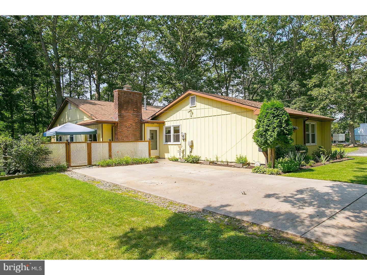 Sensational one floor home under 2 miles from Rowan University situated on a quiet, tree lined dead