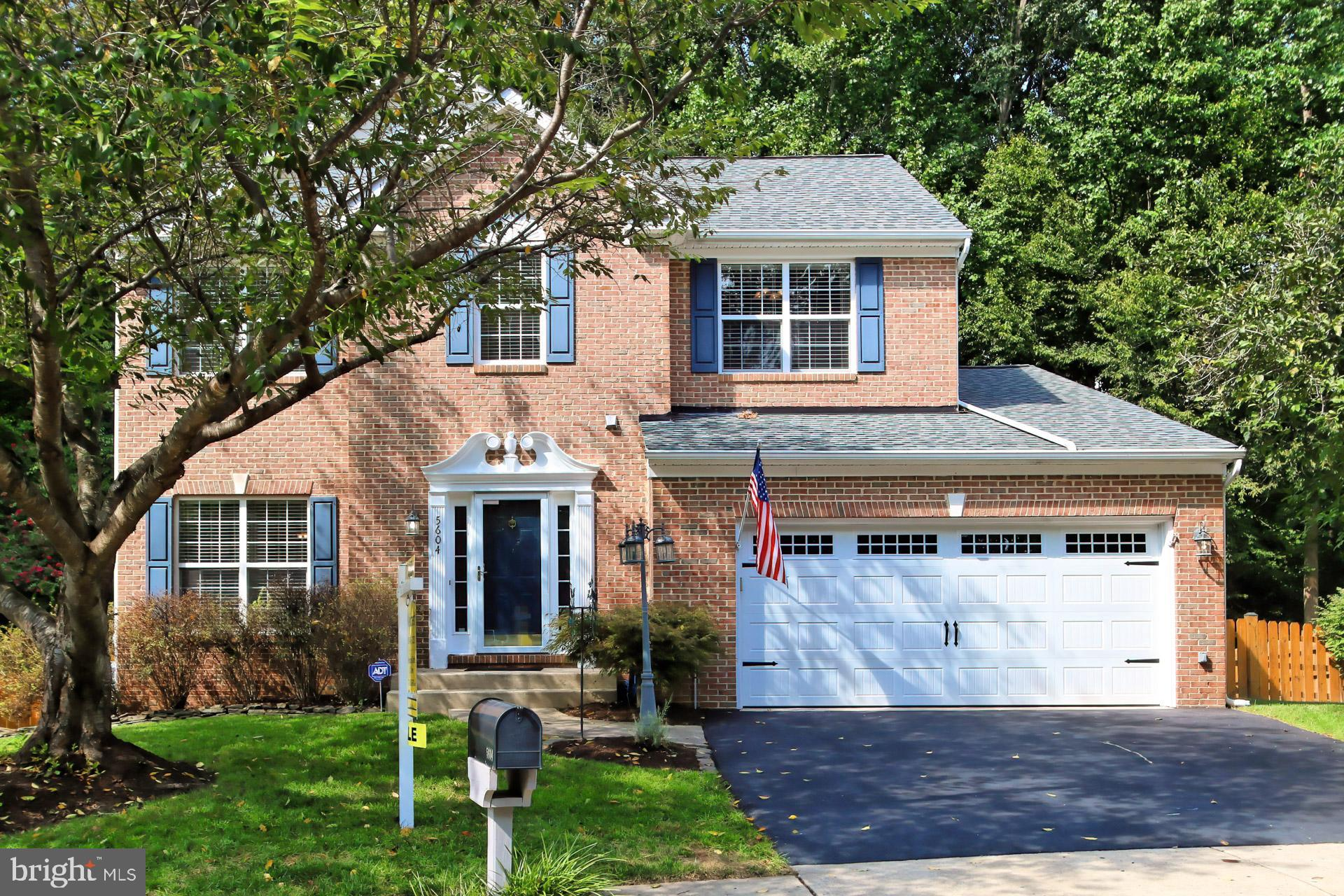 Elegant, brick-front colonial nestled on a quiet cul-de-sac in the highly sought-after community of Ashland. Wonderful eat-in kitchen with white 42-inch cabinets, black appliances, granite counters, an island/small breakfast bar, pantry, plus a convenient desk area. The large adjoining family room features a gas fireplace ready for those chilly evenings. Refinished hardwood floors throughout the main level and crown molding in the family room, living room and formal, separate dining room. The entire home has been freshly painted within the past few years, with many rooms just painted. The main level also features a cheerful laundry area with storage cabinets, and a remodeled powder room. The upper level consists of 4 bedrooms including the primary suite featuring soaring vaulted ceilings a large walk-in closet and a gorgeous, completely remodeled bath. The luxurious, spa-like primary bathroom has a double vanity with marble top, recessed, picture frame medicine cabinets, a large soaking tub and a beautiful shower with frameless shower doors. The 3 secondary bedrooms share another gorgeous, completely updated bath. The lower level has a large, finished recreation room, tons of storage space and a rough-in for a full bath. New roof in 2016. A new asphalt driveway leads to the oversized, 2 car garage featuring a new, insulated garage door, overhead racks and lots of built-in shelving. Outside, the sundeck overlooks the large, fully fenced yard backing to the Ashland Conservancy (wooded area with no homes). Across the cul-de-sac is a path leading to the community pool and clubhouse (a 2-minute walk). The Ashland community also features tennis and basketball courts, a fitness center, and a great kid's playground. Conveniently located minutes from major commuter routes, shops, restaurants and award-winning schools. Welcome home!