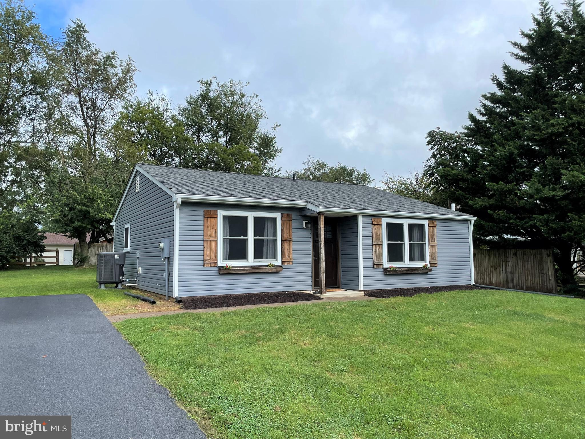 Welcome Home to 1256 Carrollyn Dr!  This fully renovated farmhouse style rancher on nearly a half ac