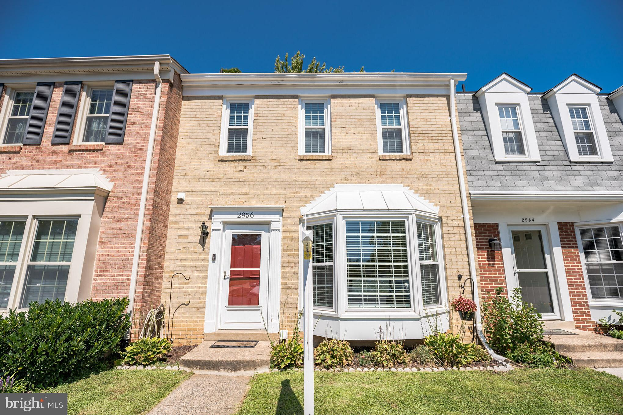 Welcome home to this beautiful brick front Colonial townhome in the sought after Waterford community