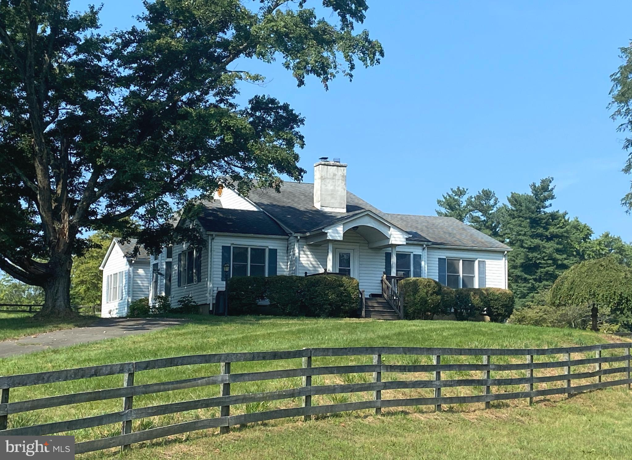 Horse lovers delight.  20+ acres of pastures.  Six stall center aisle barn with tack room and hay st
