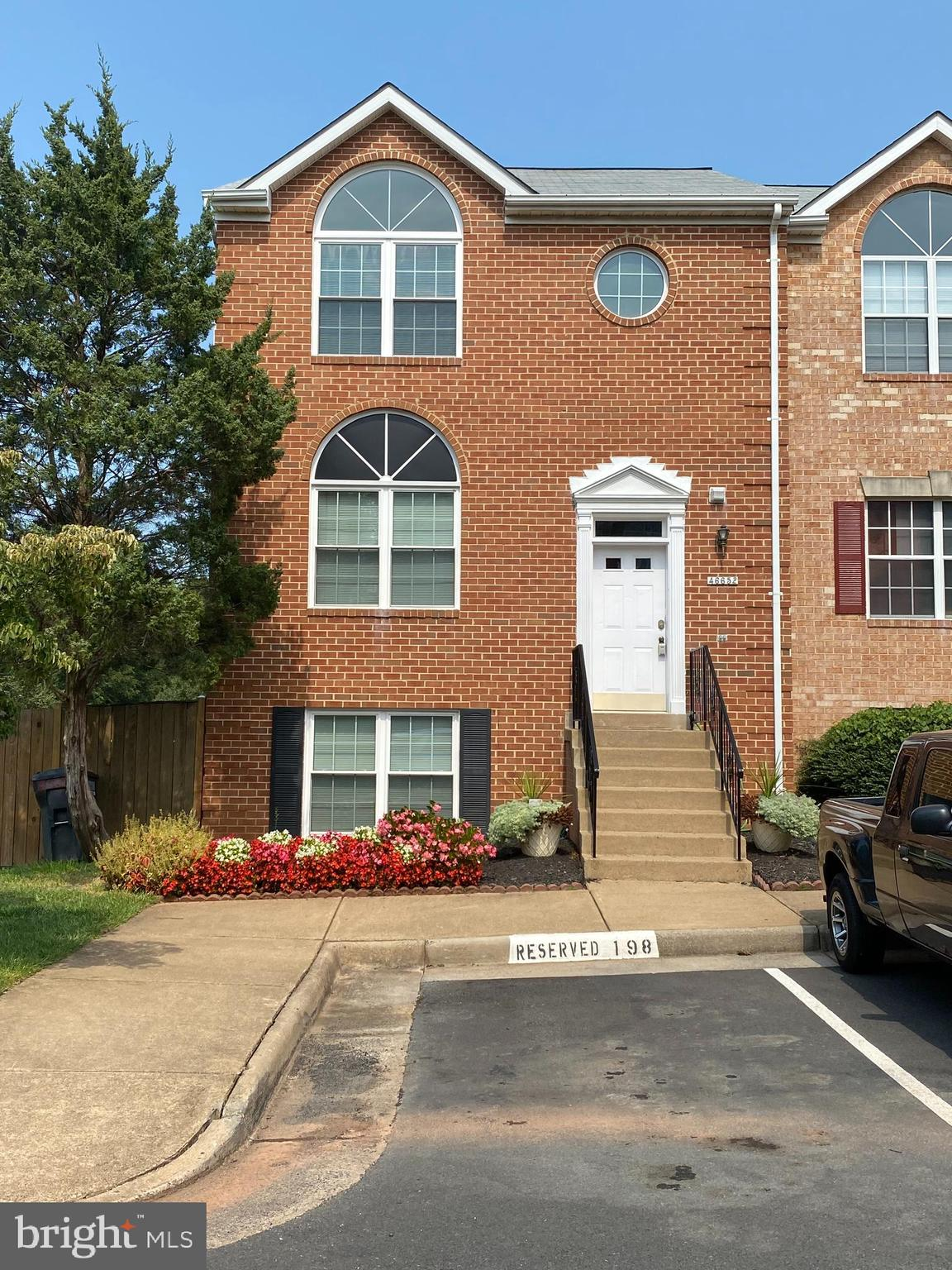 Beautiful end unit, all brick town home. 4 bedrooms, 3.5 bathrooms. Large kitchen with fireplace. St