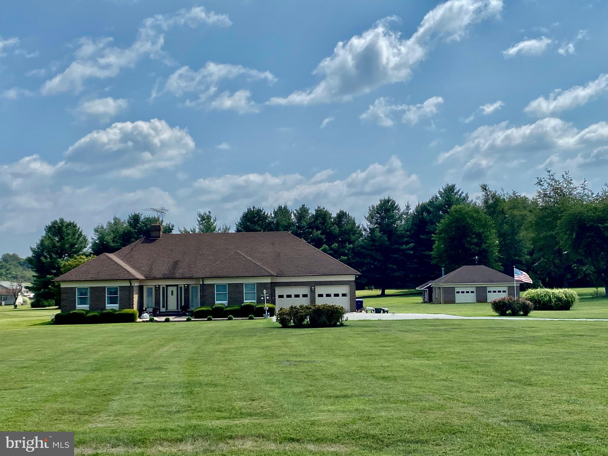 """This all Brick Custom-built Ranch style home sits on 3+ acres. The property """"features"""" an all brick"""