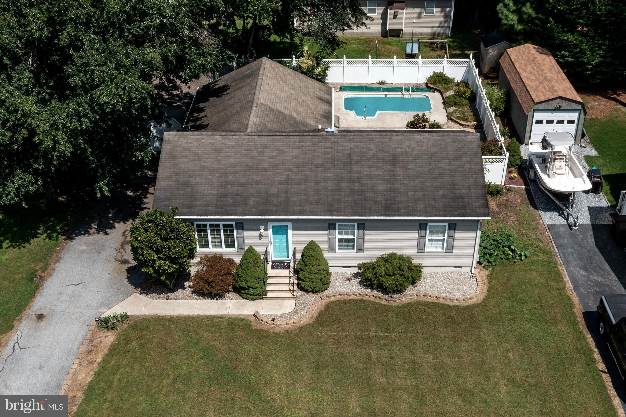 This well maintained ranch home has a big family room addition off the back overlooking an inground