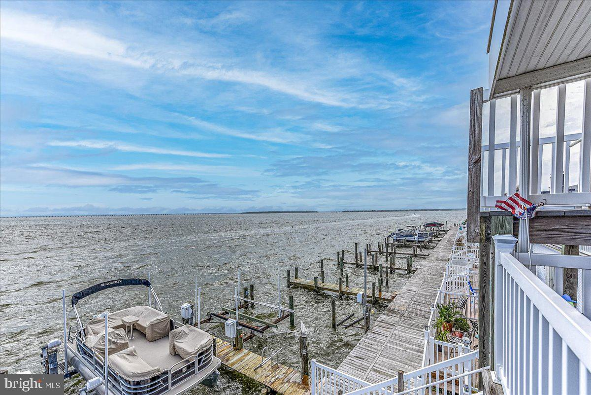 """AMAZING BAY VIEWS from this condo that is the best priced 3 bedroom, 2 bath direct bayfront property in Ocean City!  From the spacious southern facing balcony there are expansive views of the bay and the Rt.90 bridge in the distance. The balcony offers a storage shed and a 2nd storage shed is located ground level under the stairs. The open floor plan allows for wonderful bay views from the kitchen, living room and dining area! Over the years caring owners have replaced: Heat Pump (2021), bathroom hardware & toilets (2021), Stainless appliances (2019), Bathroom vanities (2016), and Bamboo flooring throughout. For the boater, the unit comes with a boat slip that has a 8K lb lift. Rusty Anchor East is conveniently located in the """"Little Salisbury"""" neighborhood off 94th St. which allows for quick access to the beach and is close to the community basketball & tennis courts, kids playground, dog park, many restaurants, coffee shop, shopping and grocery store. The location of this building is also a great area for walking and biking around the neighborhood. The building updated the roof, balconies & vinyl railings about 6 years ago. What a great opportunity to own a direct bayfront condo in Ocean City!"""