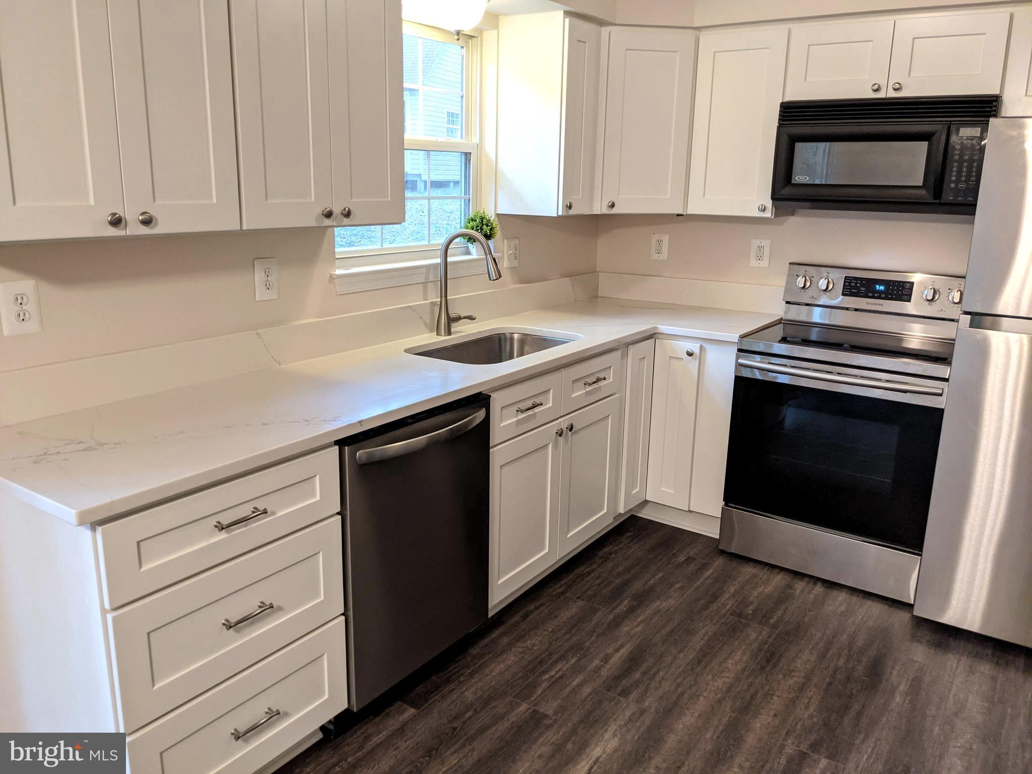 Move in ready with A TON of new and recent updates and upgrades!   Brand new kitchen cabinets, gorge