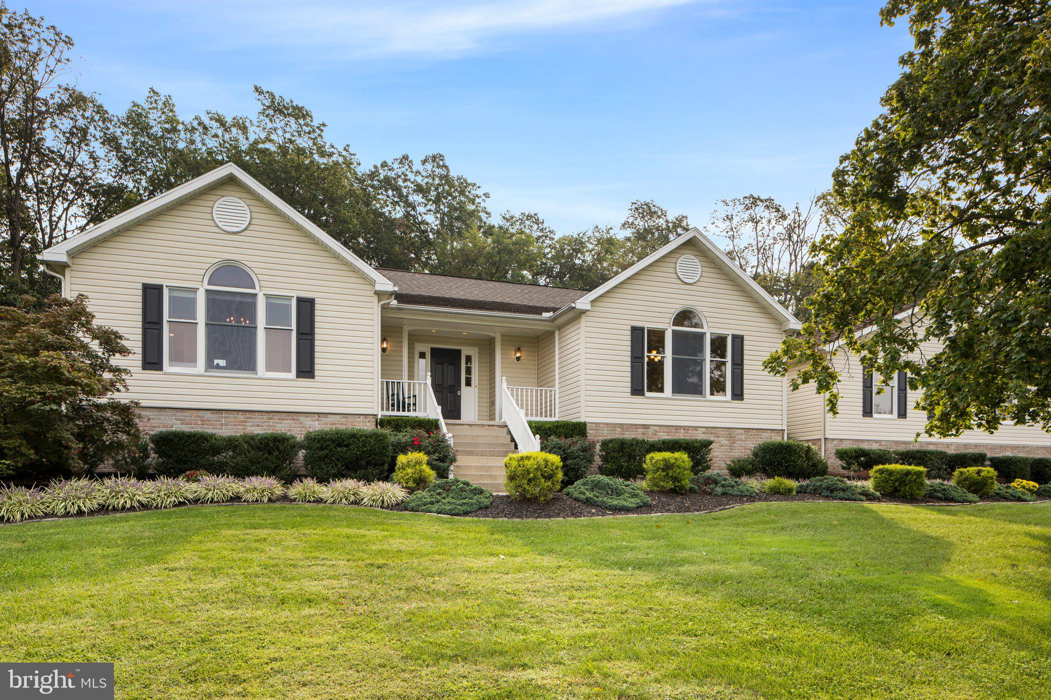 You do not want to miss seeing this stunning property. Gorgeous, updated Rancher that sits on over o