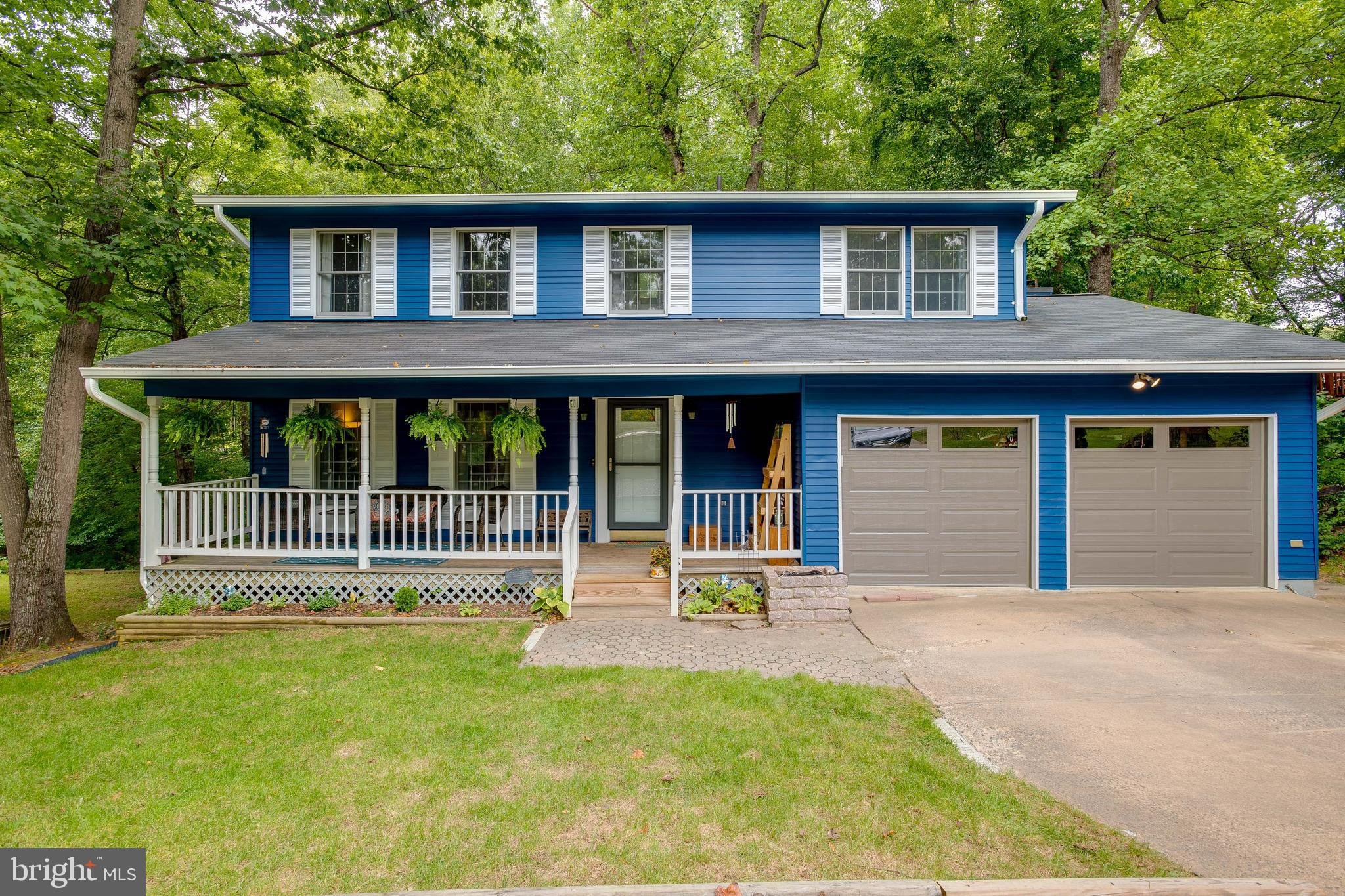 Beautiful single family colonial home in sought after Aquia Harbor! Enjoy the covered front porch an