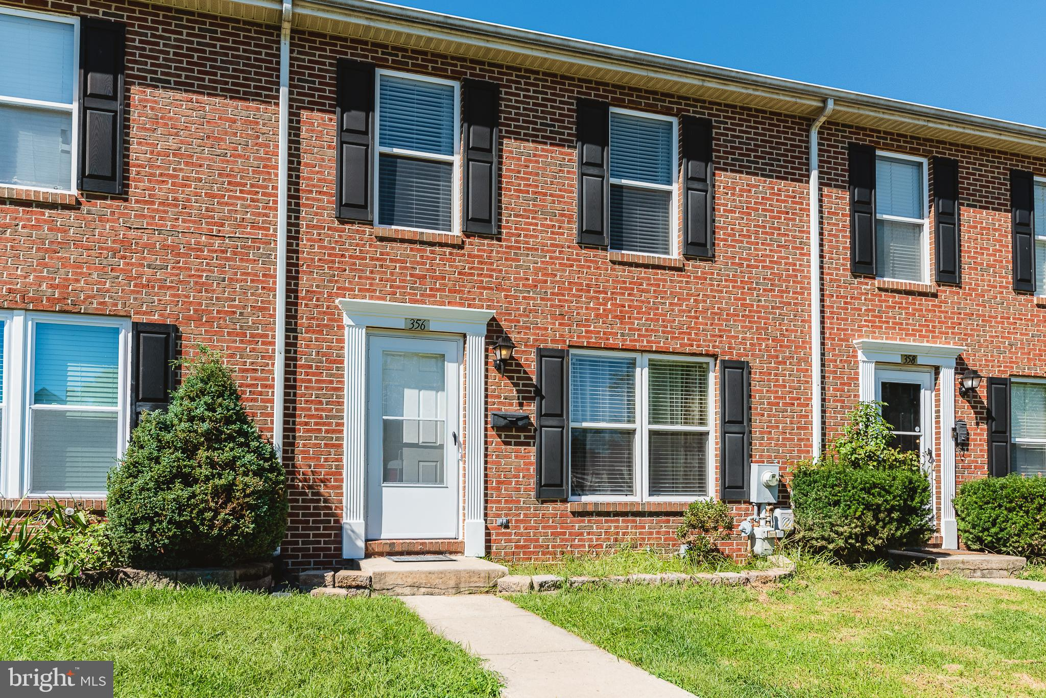 Brick Front Interior Townhome Backing to Open Space!  Fresh Paint, New Carpet, Newer Appliances!  No