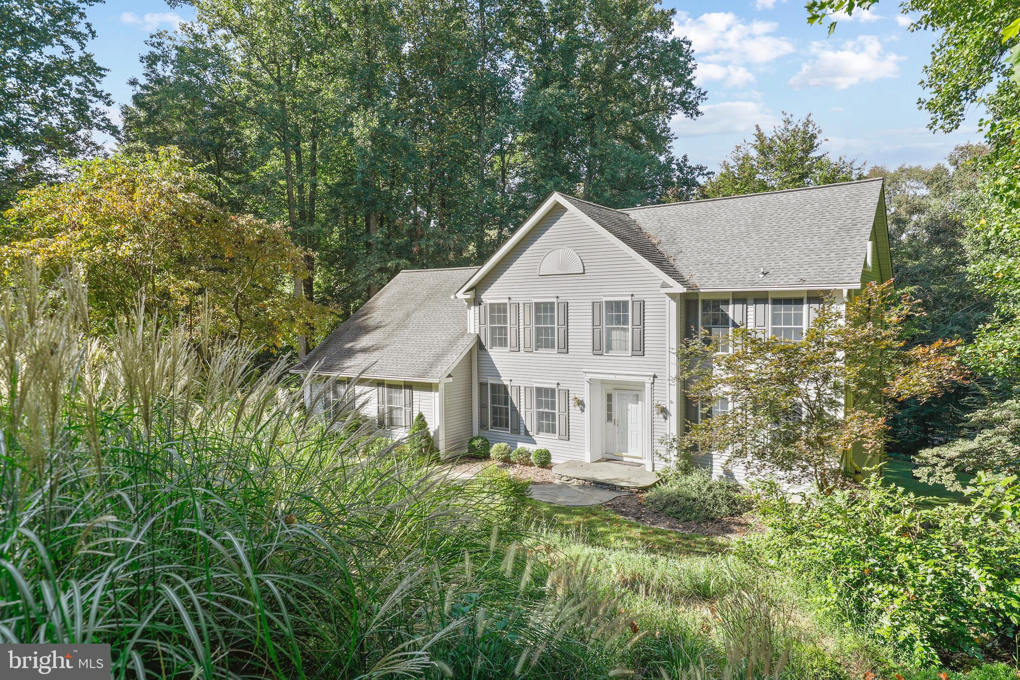 Enchanting Colonial, nestled upon a private 1.43-acre lot complete with captivating views of Patapsc
