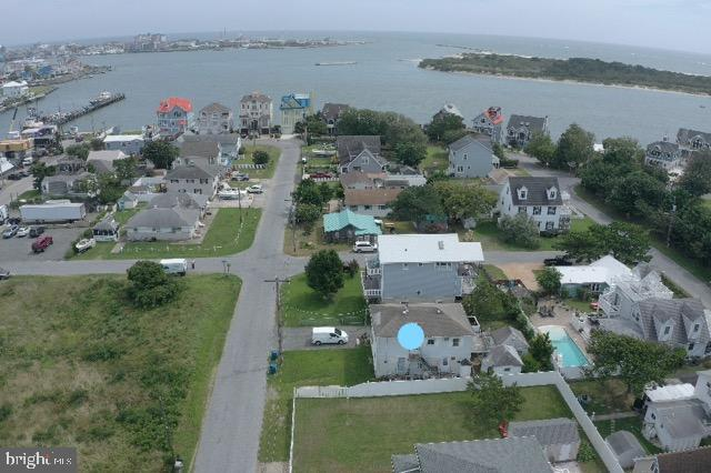 A rare opportunity! This property is in a neighborhood unique to the Eastern Shore of Maryland that you just can't find anywhere.  Only a few steps away from the commercial harbor, seafood markets and restaurants.  The home is currently rented and the tenant is there through the month of September.  This could be a project or a complete redo.  The structure is of little value but offers tons of potential.  With the right plan you could turn it into your dream beach home or the seller will negotiate demolition so you can start with a blank canvas. There is public sewer, electric service and a well for which the water quality test results are available.
