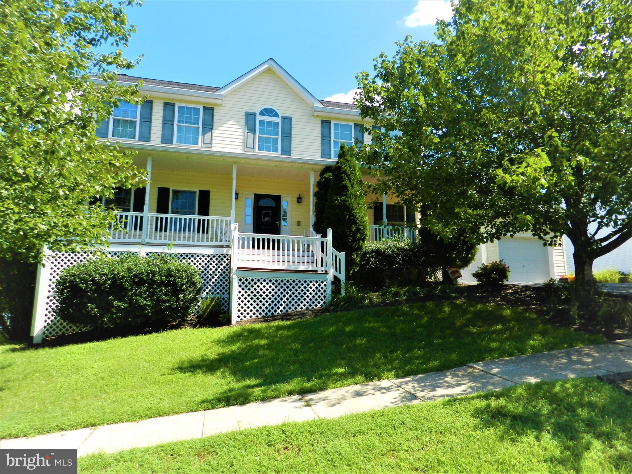 Welcome to this beautifully maintained 3-level home in the highly sought after northern Calvert Cros